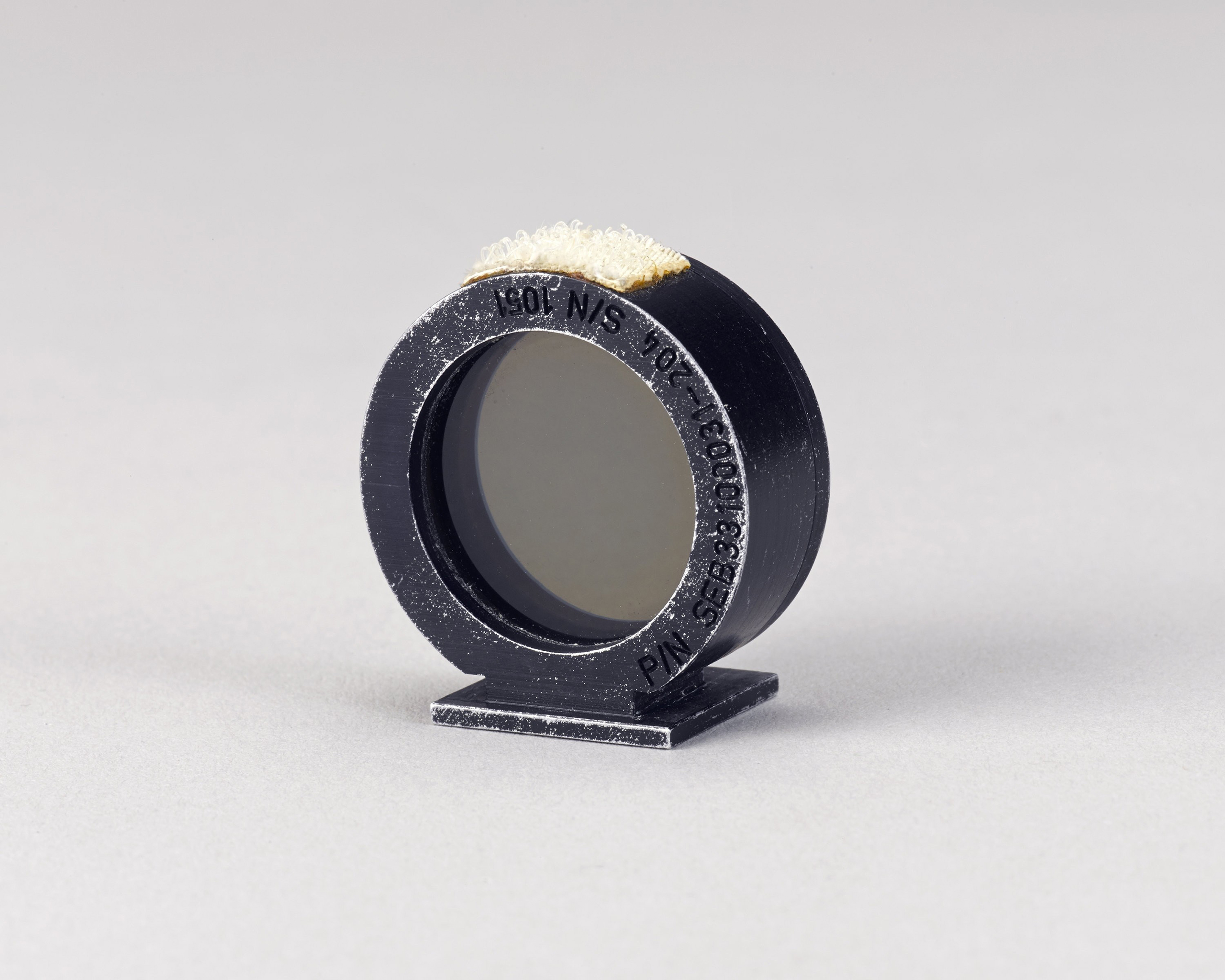 Motion picture ring sight used on the Moon during Apollo 15. This camera accessory was used by astronaut James B, Irwin on the 16mm camera inside the lunar module in 1971. It was on the lunar surface for 66 hours.