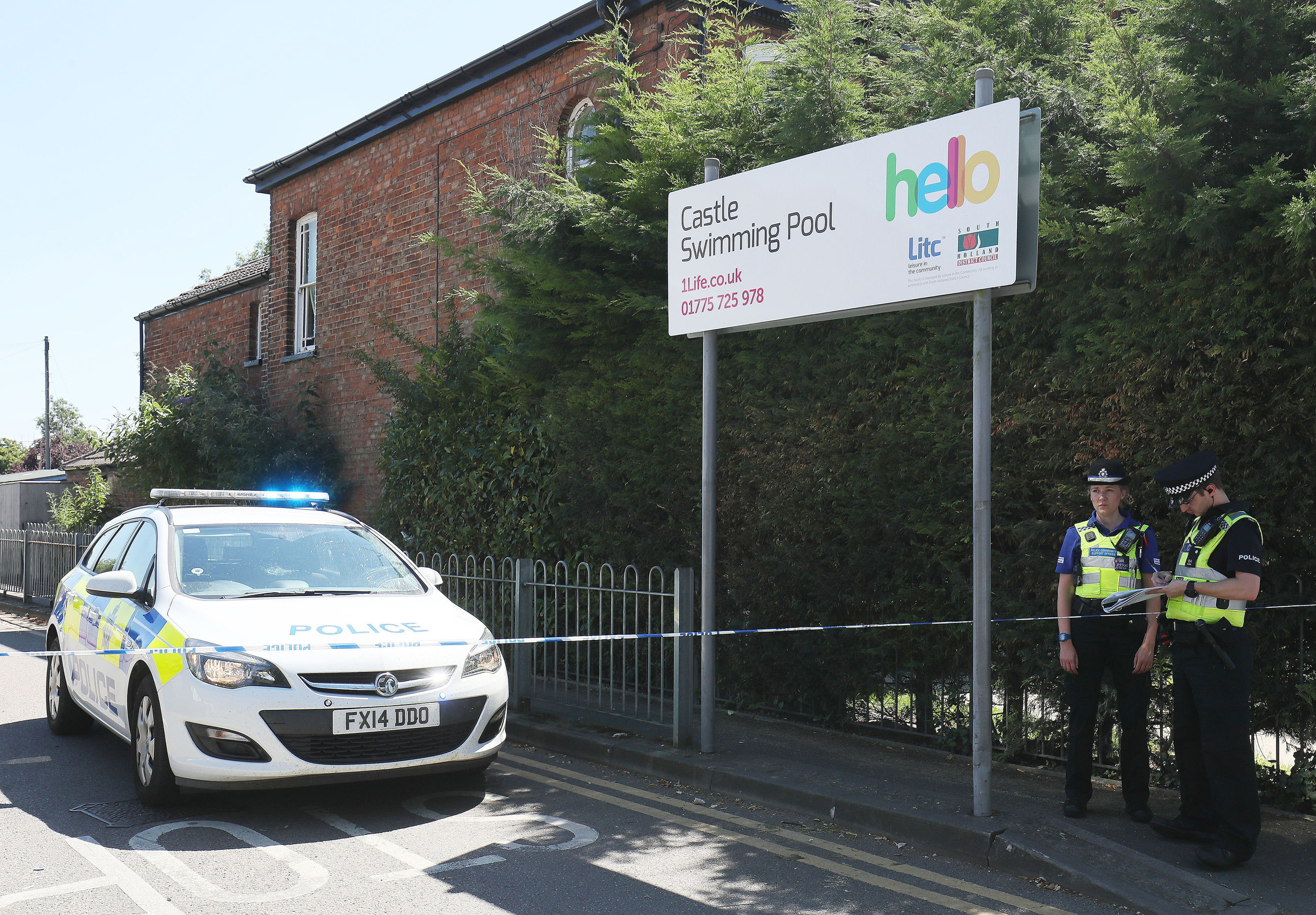 Emergency services at the scene near Castle Swimming Pool after three people including a suspected gunman have been shot dead in Spalding, Lincolnshire on July 19, 2016.