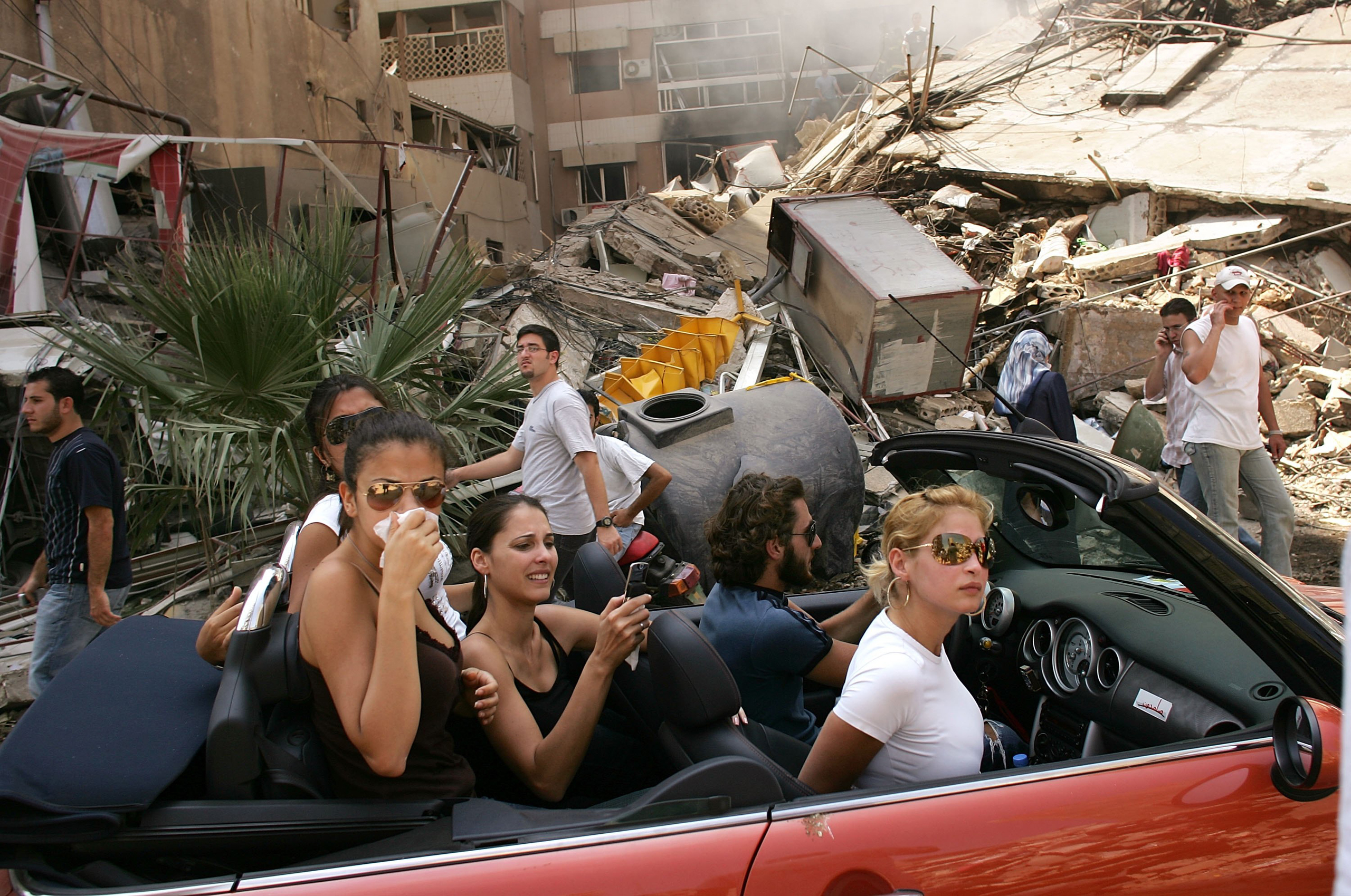 Like all images of conflict, I have mixed feelings about this picture I took in south Beirut in 2006. I see it every morning framed on a stark white wall in my Brooklyn apartment. The opaque nature of reality in the Middle East is captured in the image. The beautiful subjects in the red Mini Cooper driving through a devastated neighborhood took offense at how they were depicted. They falsely claimed to reporters that they were actually refugees. The way I was subsequently treated by numerous members of the media made me want to leave the profession and go someplace far away. For me, this picture also stirs feelings of hopelessness for the region. War has developed a vicious tenacity in the Middle East. It seems to only get bloodier and darker with each passing year. News pictures are a hostage to time and place, liberating them from the fallout of what happens in the days and months after the click of the shutter.