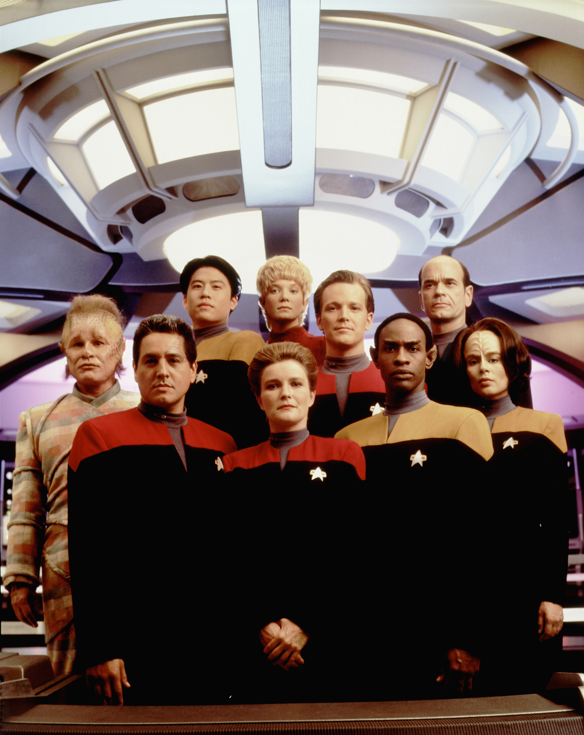 Cast of Star trek Voyager, first season, from left: Neelix (Ethan Phillips), Chakotay (Robert Beltran), Harry S.L. Kim (Garrett Wang), Kathryn Janeway (Kate Mulgrew), Kes (Jennifer Lien), Thomas Eugene Paris (Robert Duncan McNeill), Tuvok (Tim Russ),  The Doctor  (Robert Picardo), B'Elanna Torres (Roxann Dawson), 1995.