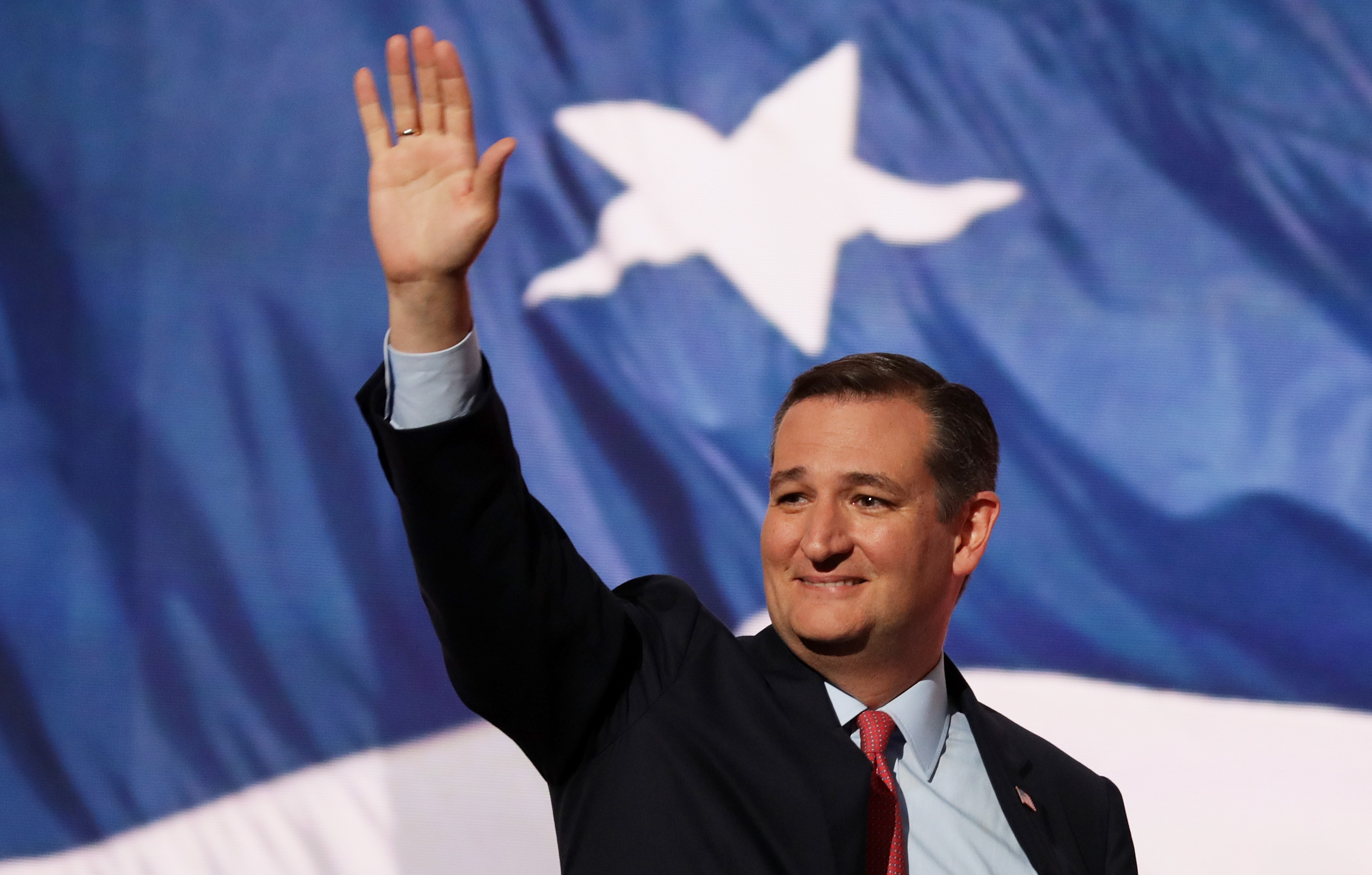 Sen. Ted Cruz (R-TX) waves to the crowd as he walks on stage to deliver a speech on the third day of the Republican National Convention on July 20, 2016 at the Quicken Loans Arena in Cleveland, Ohio.
