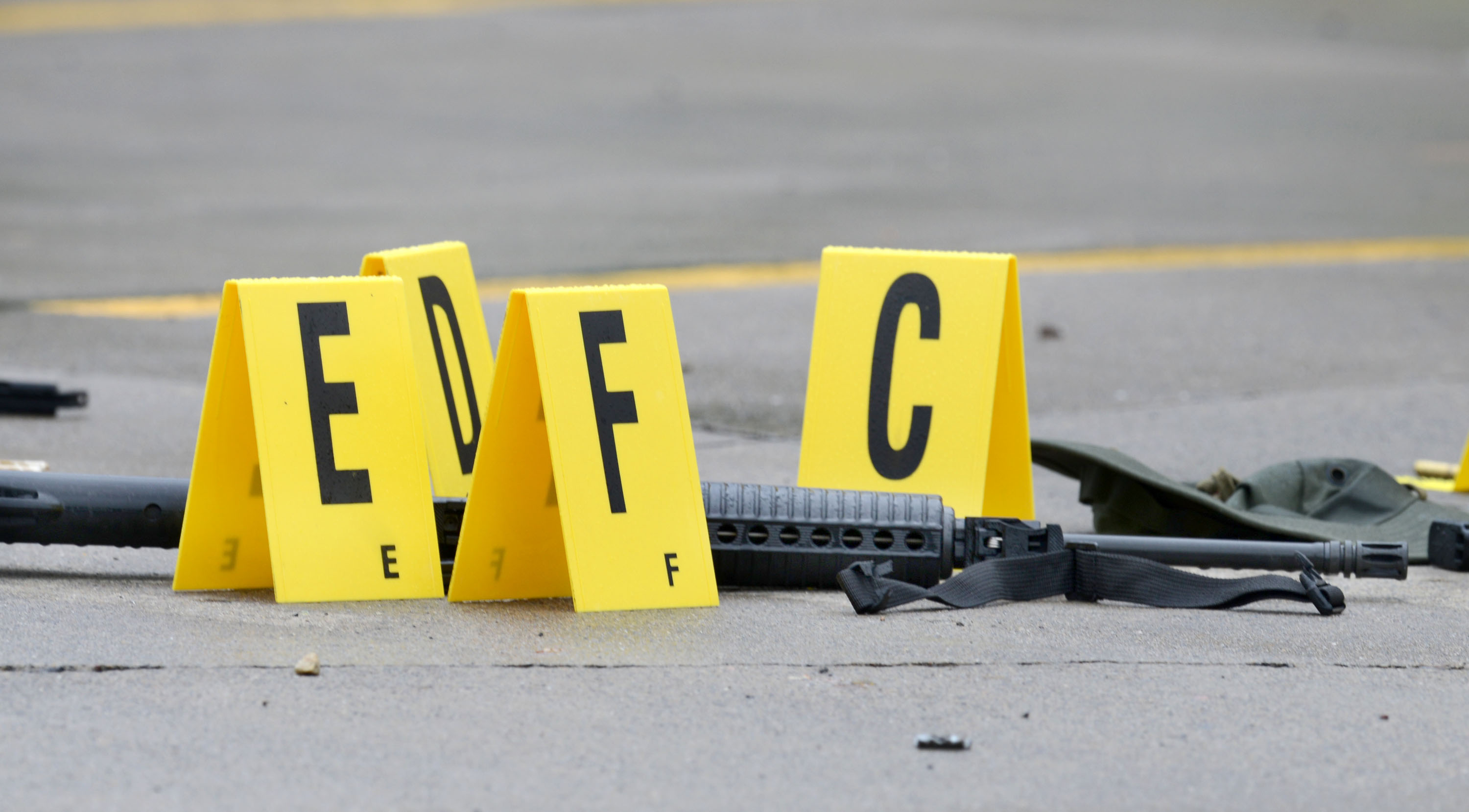 A weapon lays on the ground next to evidence markers in Bristol, Tenn., July 7, 2016.