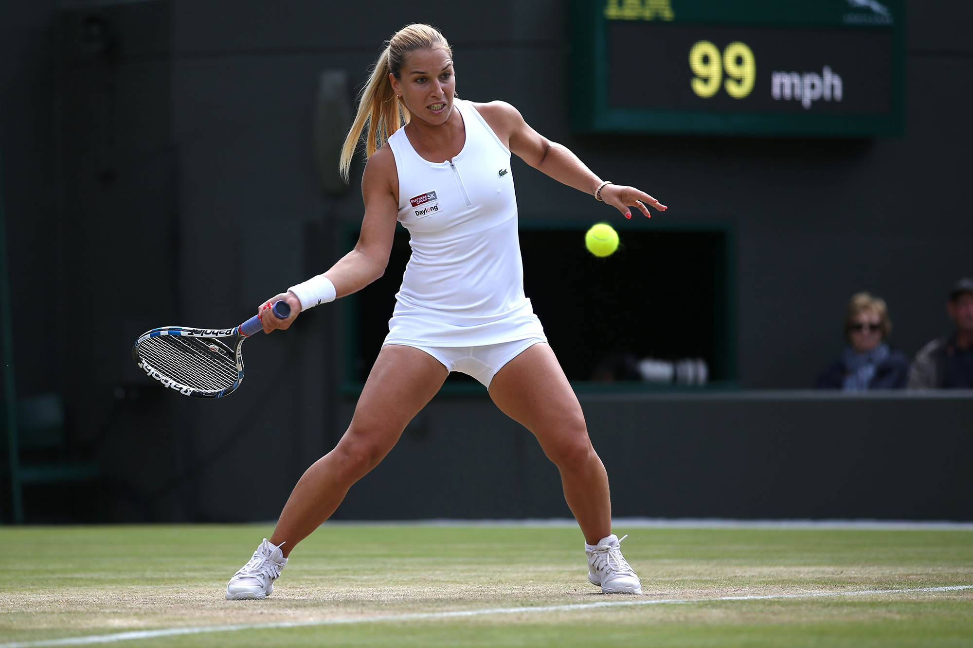 Slovakia's Dominika Cibulkova returns to Russia's Elena Vesnina during their women's singles quarter-final match on the ninth day of the 2016 Wimbledon Championships at The All England Lawn Tennis Club in Wimbledon, southwest London, on July 5, 2016. (JUSTIN TALLIS/AFP/Getty Images)