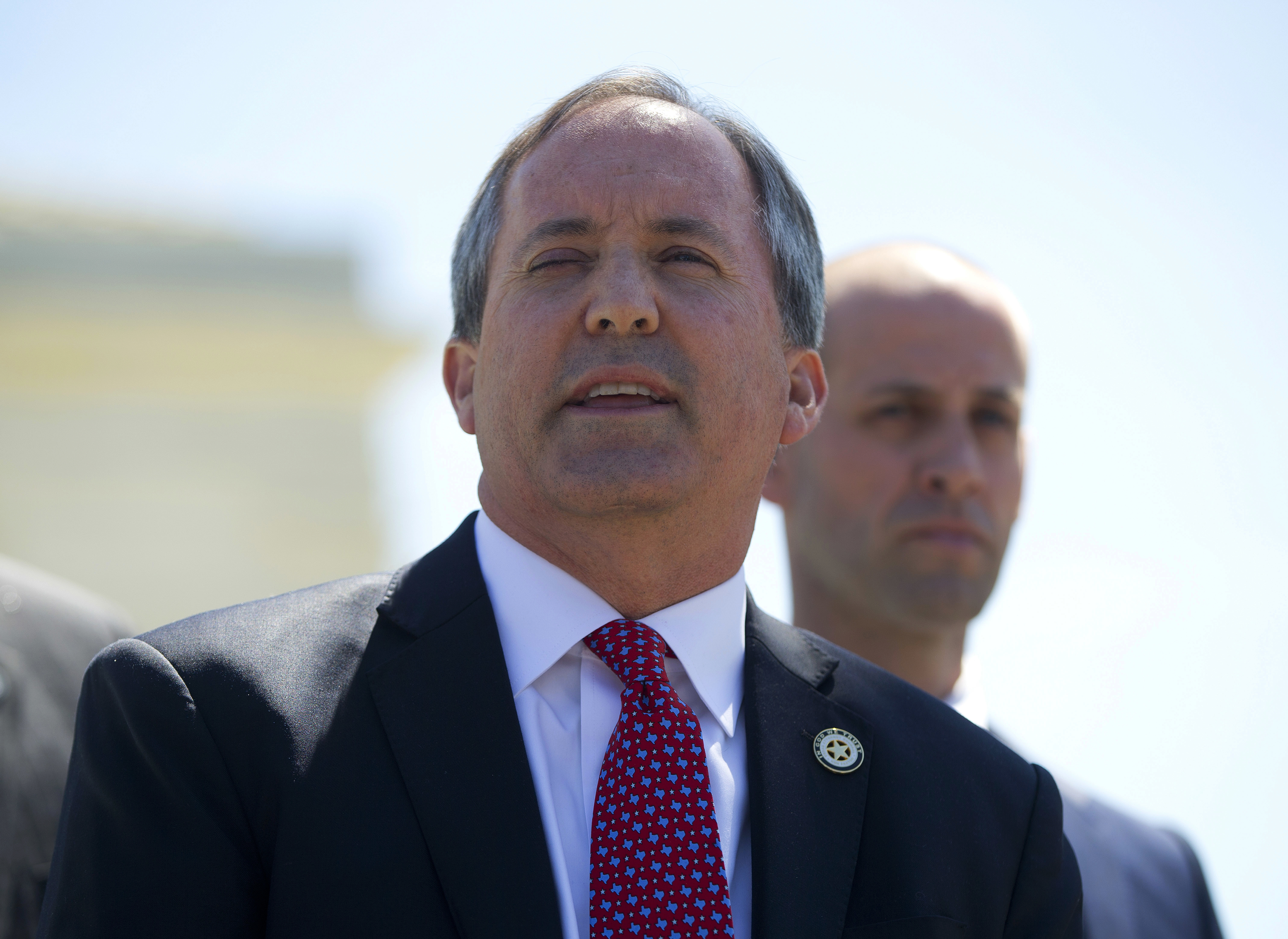 Texas Attorney General Ken Paxton meets with members of the media at the Supreme Court in Washington on April 18, 2016.