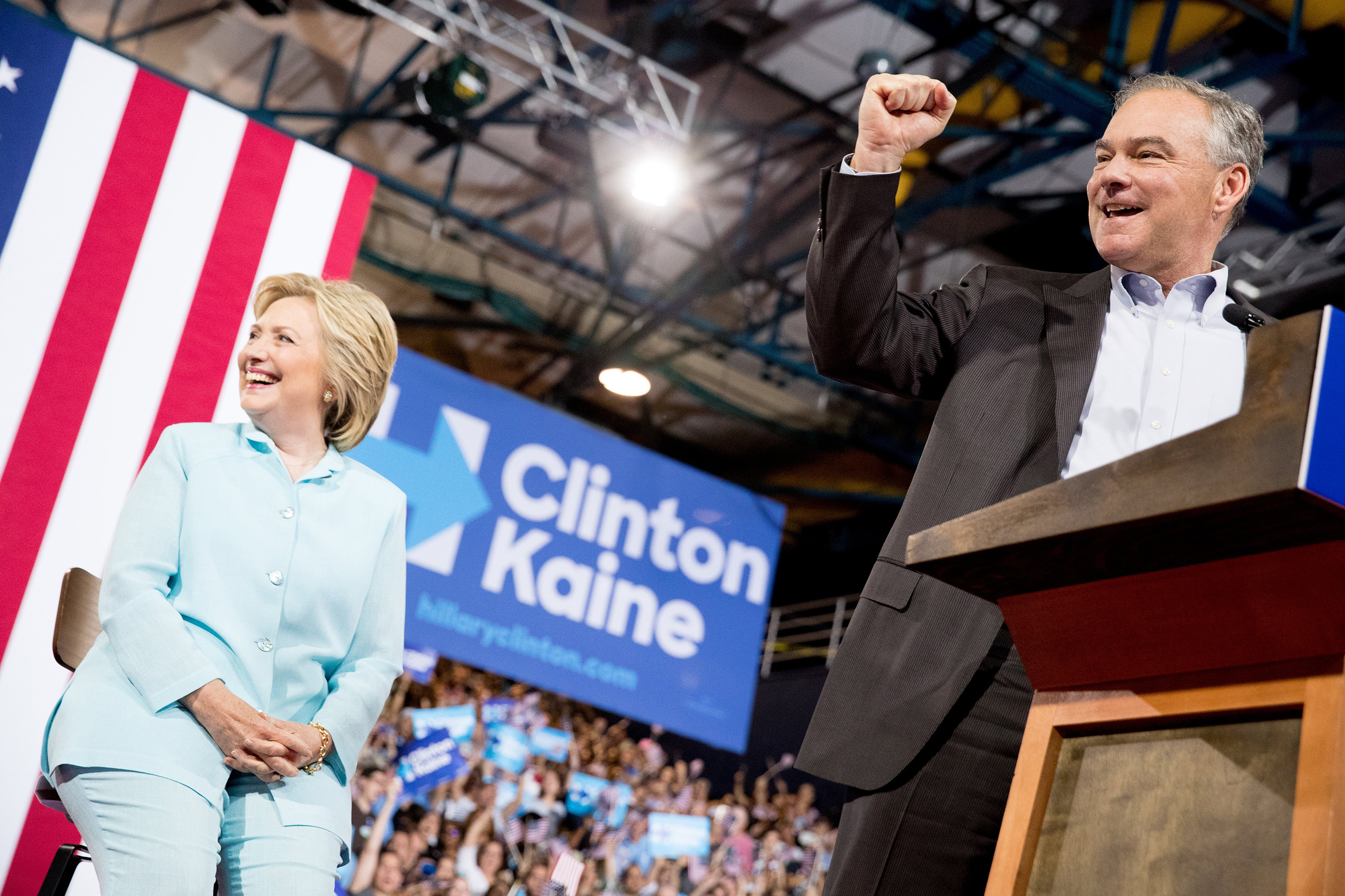 Sen. Tim Kaine, D-Va., right, accompanied by Democratic presidential candidate Hillary Clinton, left, speaks at a rally at Florida International University Panther Arena in Miami, Saturday, July 23, 2016. Clinton has chosen Kaine to be her running mate. (AP Photo/Andrew Harnik)