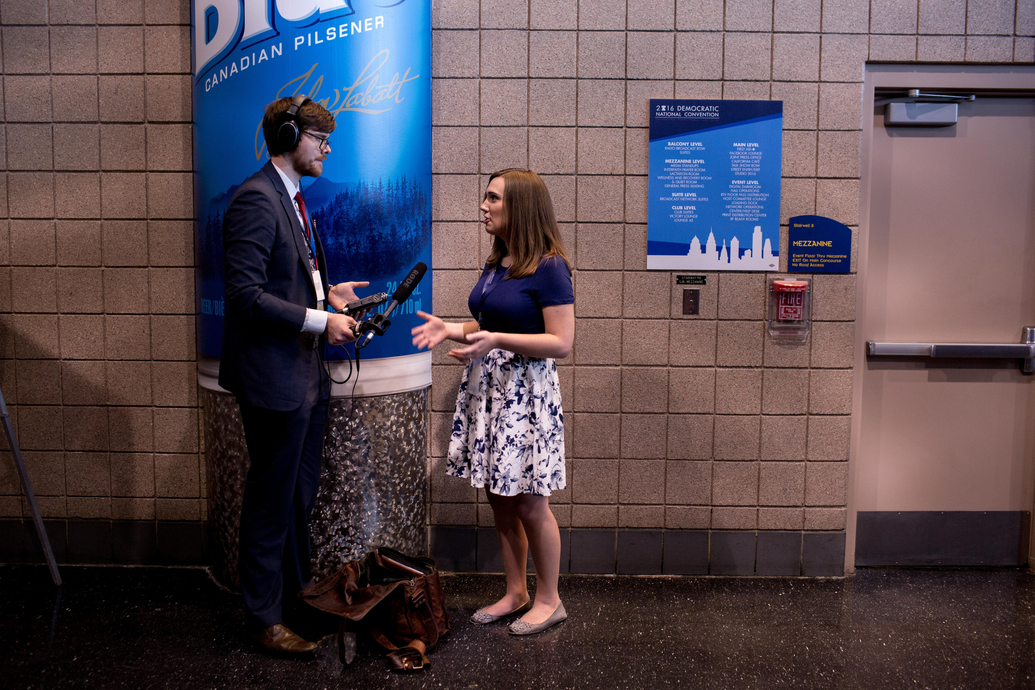 Sarah McBride is interviewed by a radio journalist at the Wells Fargo Center where she is attending Democratic National Convention on July 25, 2016 in Philadelphia.