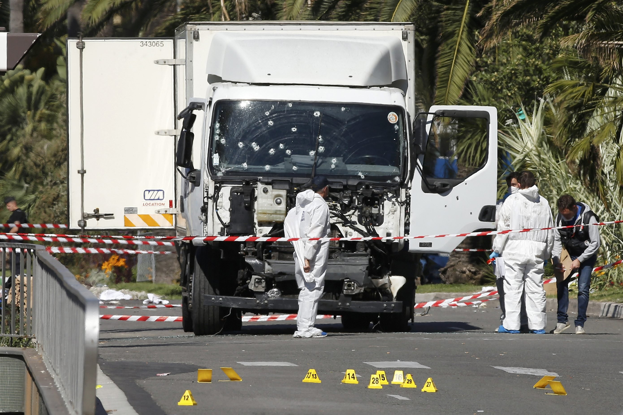 Investigators continue to work at the scene near the truck that was driven into a crowd at high speed, killing scores who were celebrating Bastille Day on July 14, on the Promenade des Anglais in Nice, France, on July 15, 2016.
