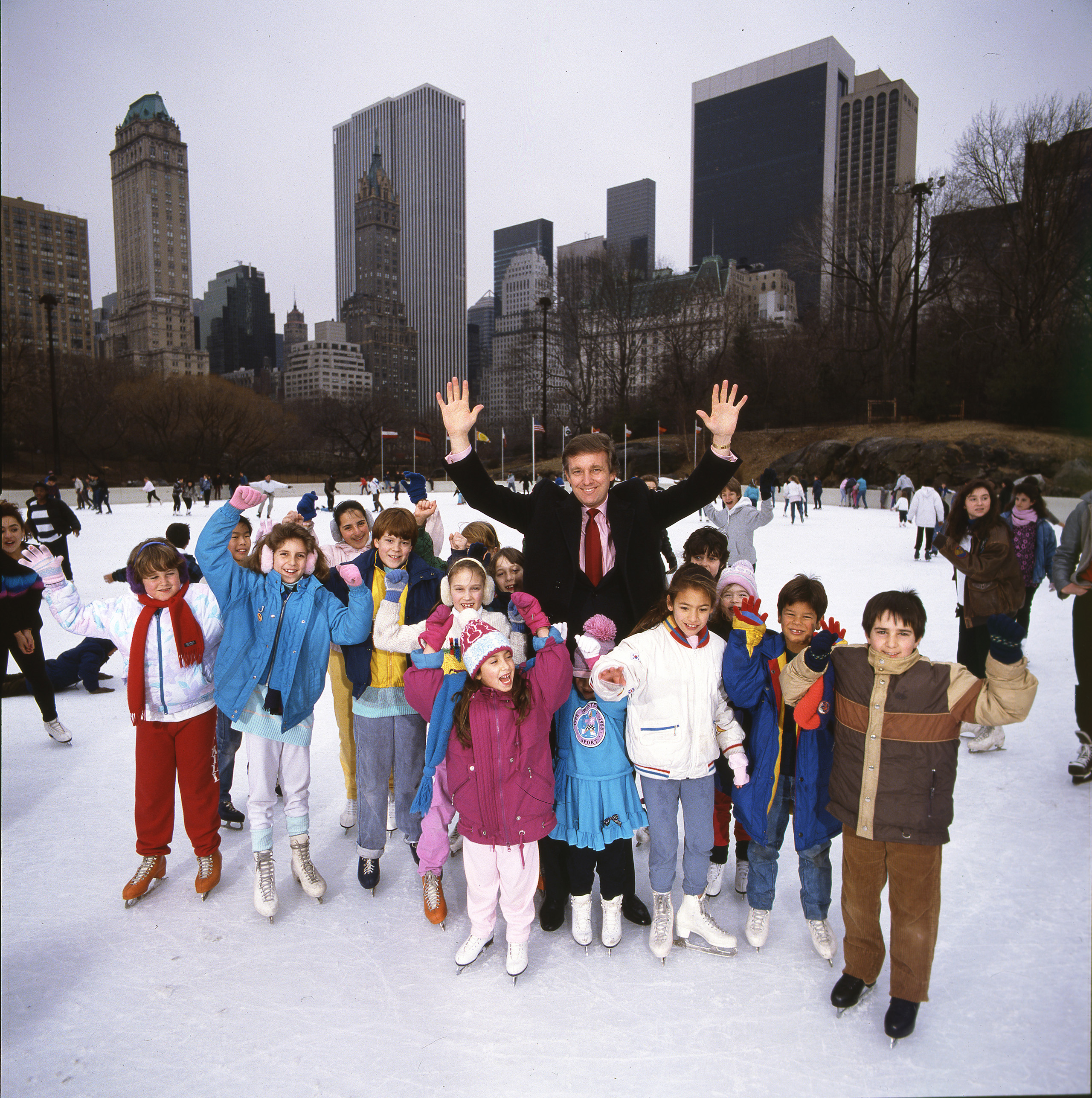 <b>1986</b> Trump celebrates after the completion of repairs to Wollman Rink in Central Park. He got the contract from the city, finishing early and well under budget.