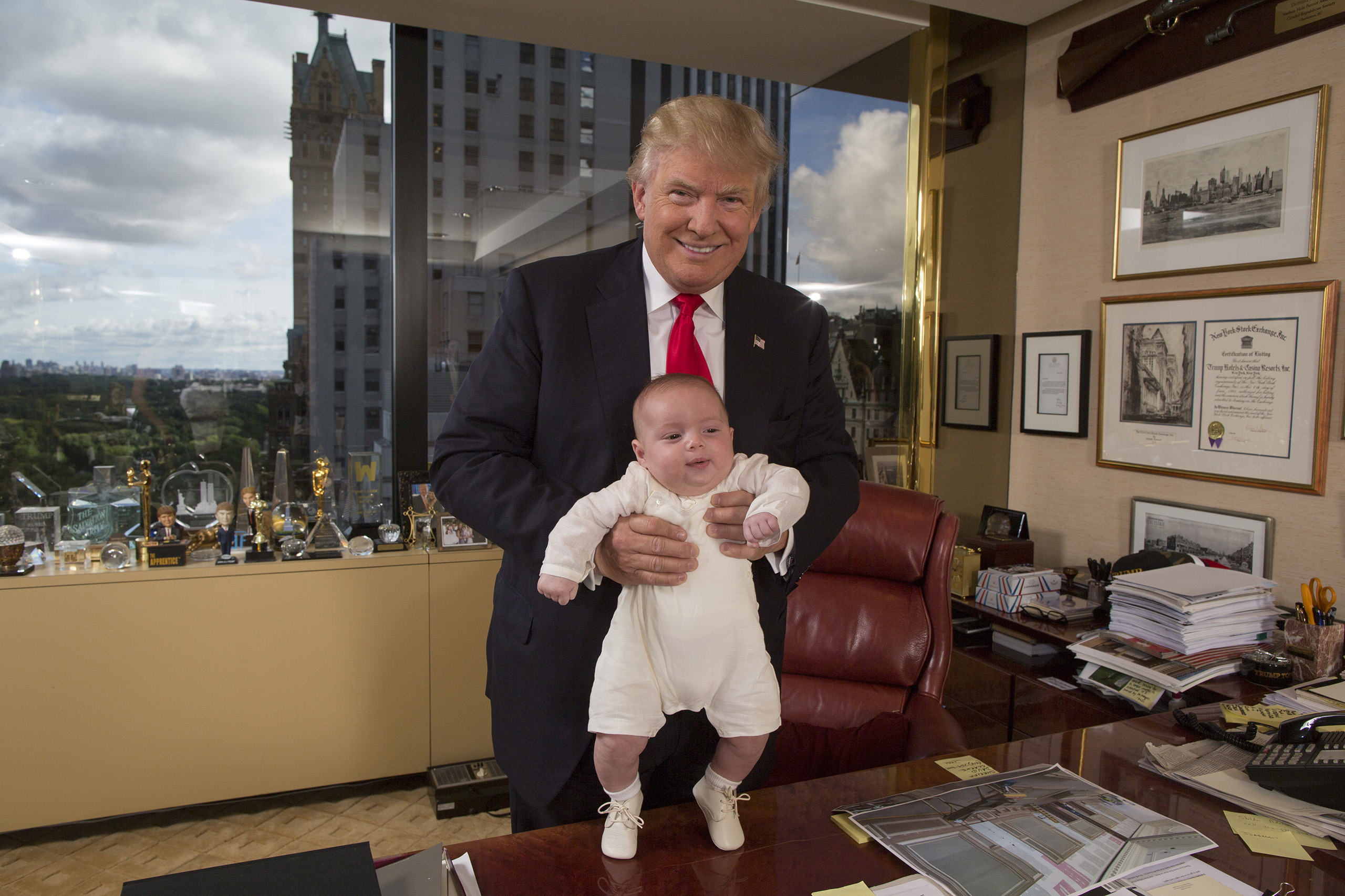Republican presidential candidate Donald Trump with his grandson Theodore James in Trump's office in New York City on July 11, 2016.
