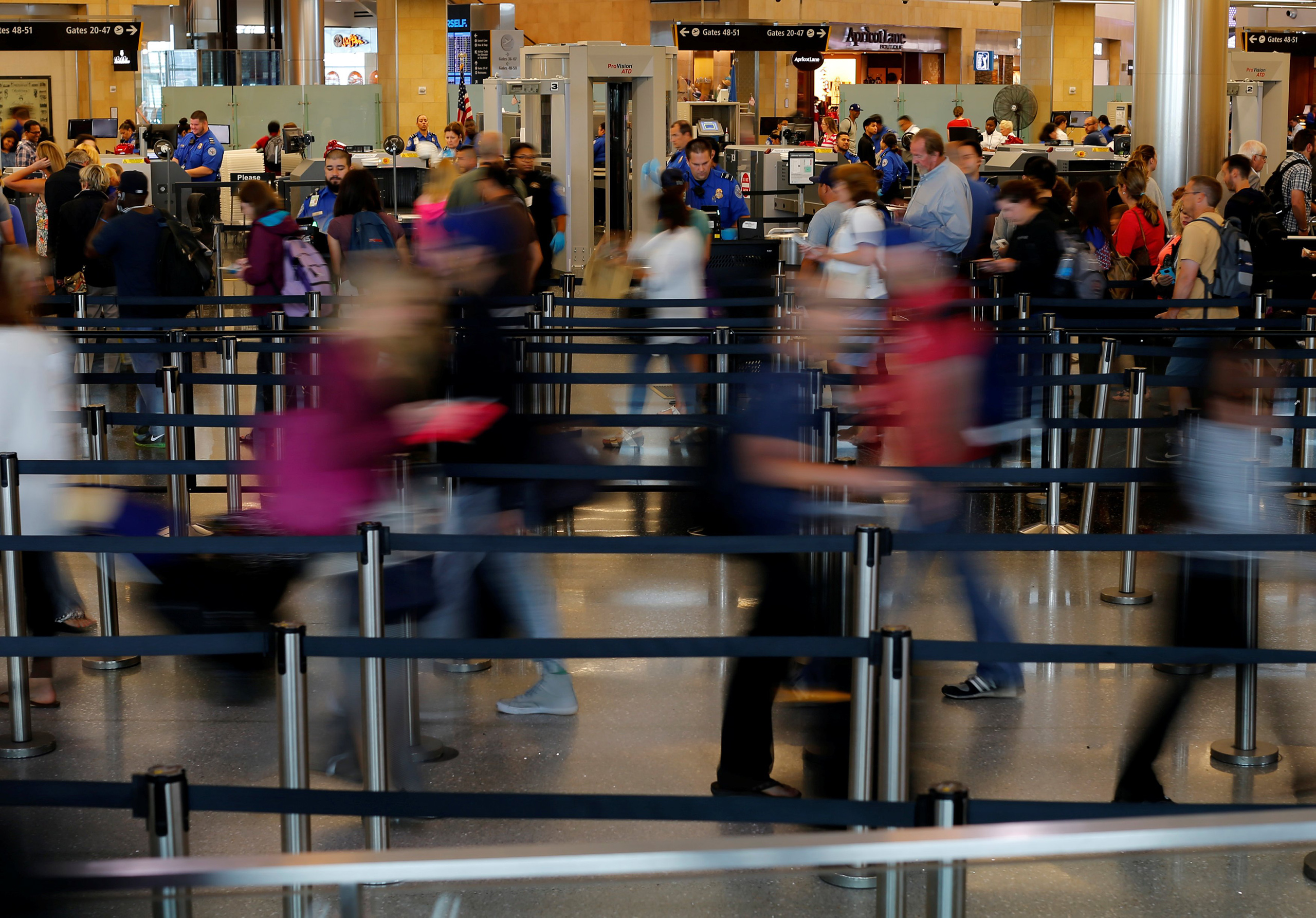 Travelers makes their way through TSA security at Lindbergh Field airport in San Diego, Calif., July 1, 2016.