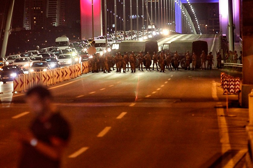 Turkish soldiers block Istanbul's Bosphorus Bridge, which separates the European and Asian sides of the city, on July 15, 2016.