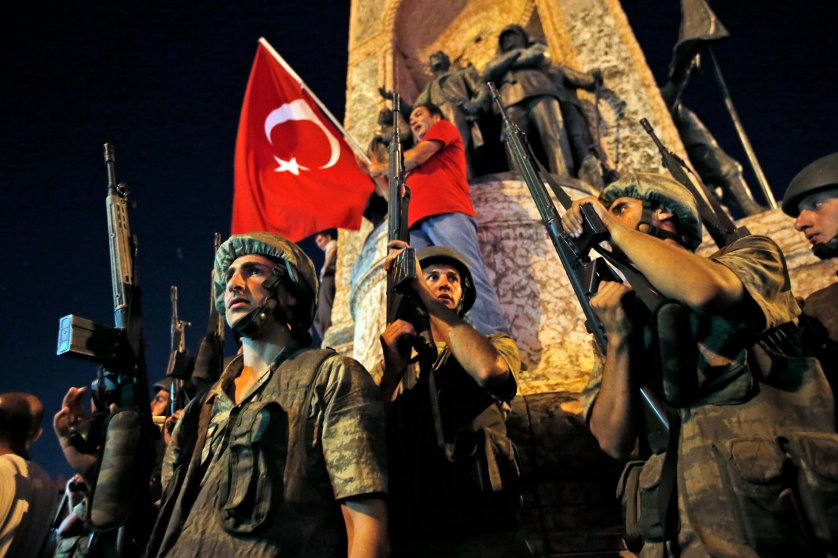 Turkish soldiers secure the area as supporters of President Recep Tayyip Erdogan protest in Istanbul's Taksim Square early on July 16, 2016.
