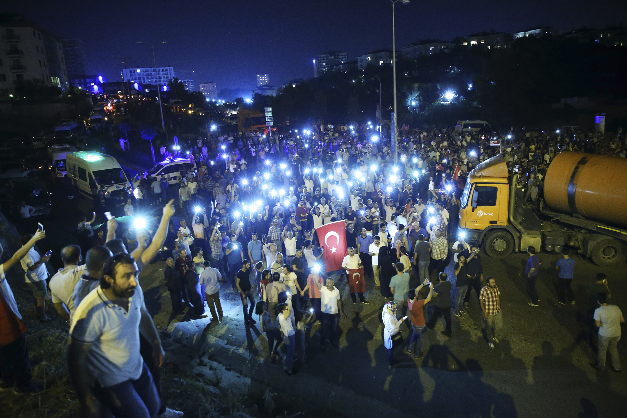 People gather with their mobile phones to react against the military coup attempt in the Tuzla District of Istanbul, Turkey, on July 16, 2016.