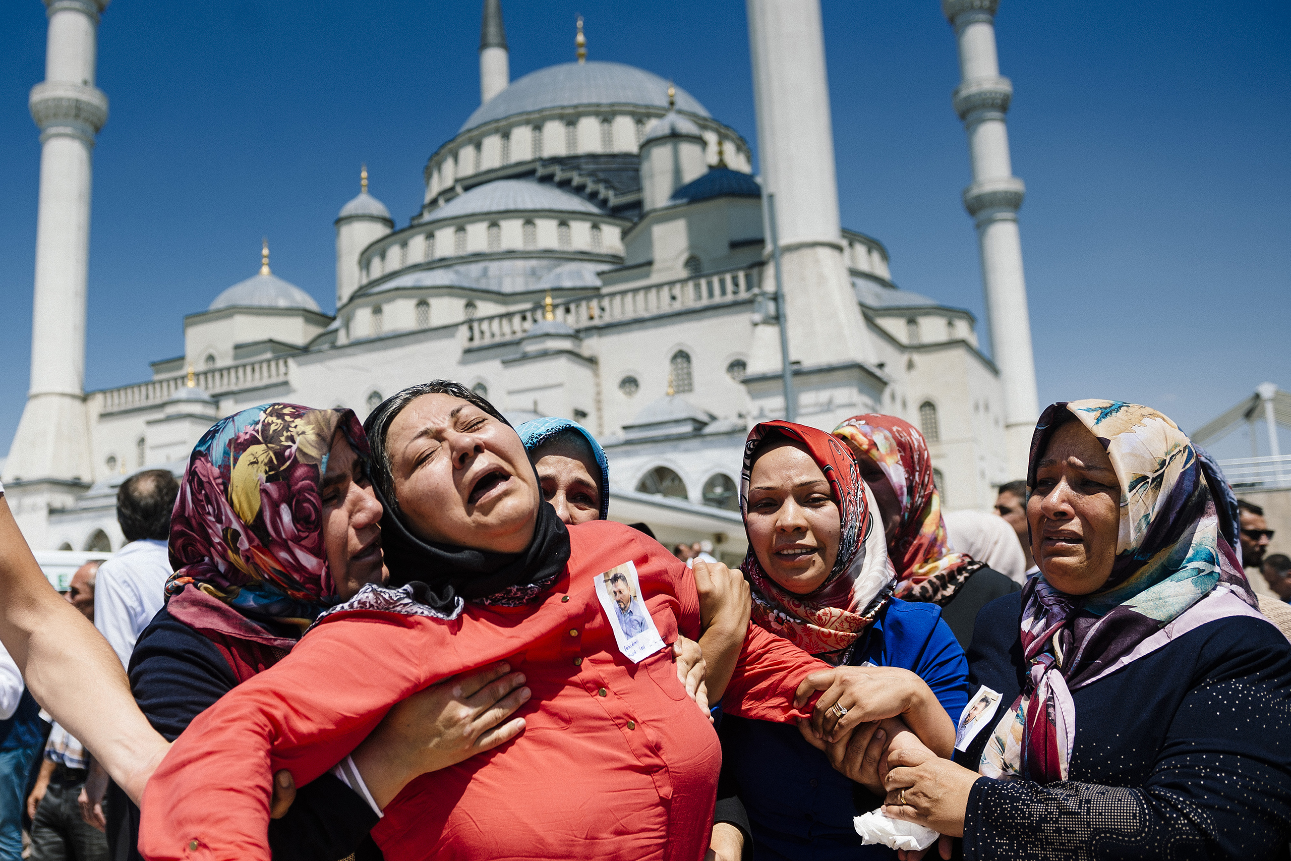 Women react during the funeral ceremony of Sehidmiz Murat Inci, a victim of the coup attempt, at Kocatepe Mosque in Ankara, Turkey, on July 18, 2016.