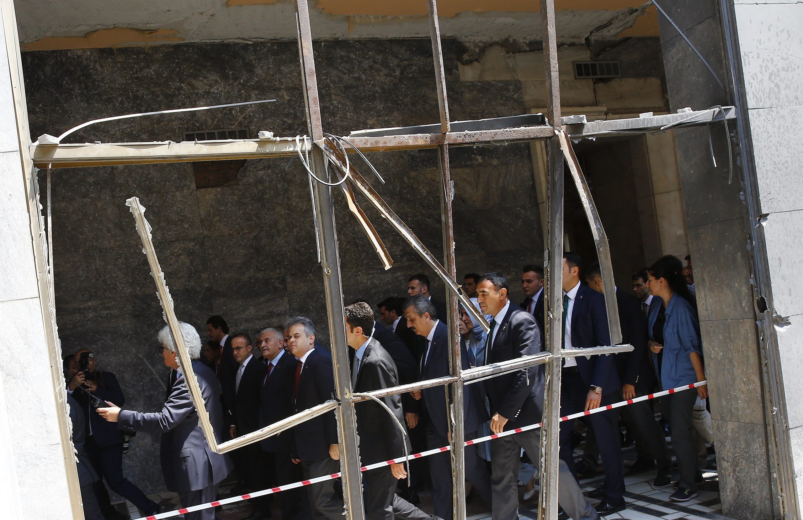 Turkey's Prime Minister Binali Yildrim visits damaged parts of the Turkish parliament in Ankara on July 19, 2016.