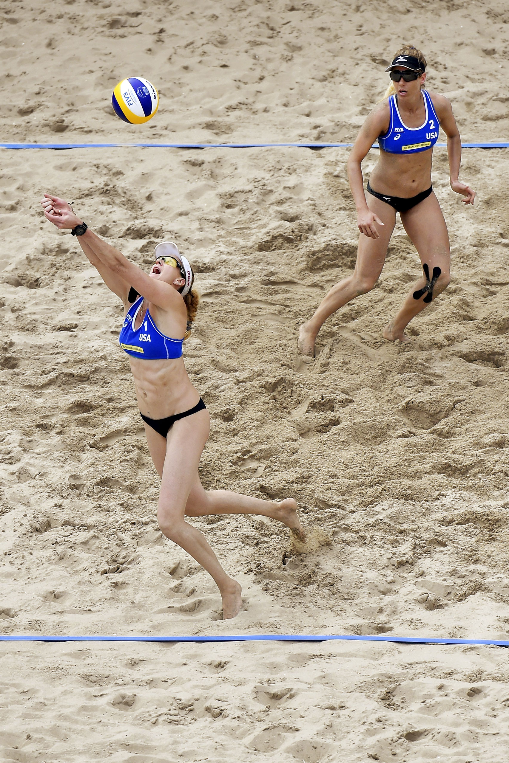 Kerri Walsh Jennings and April Ross of the United States during their semi-final match at the 2016 FIVB Rio Grand Slam in Rio de Janeiro, Brazil