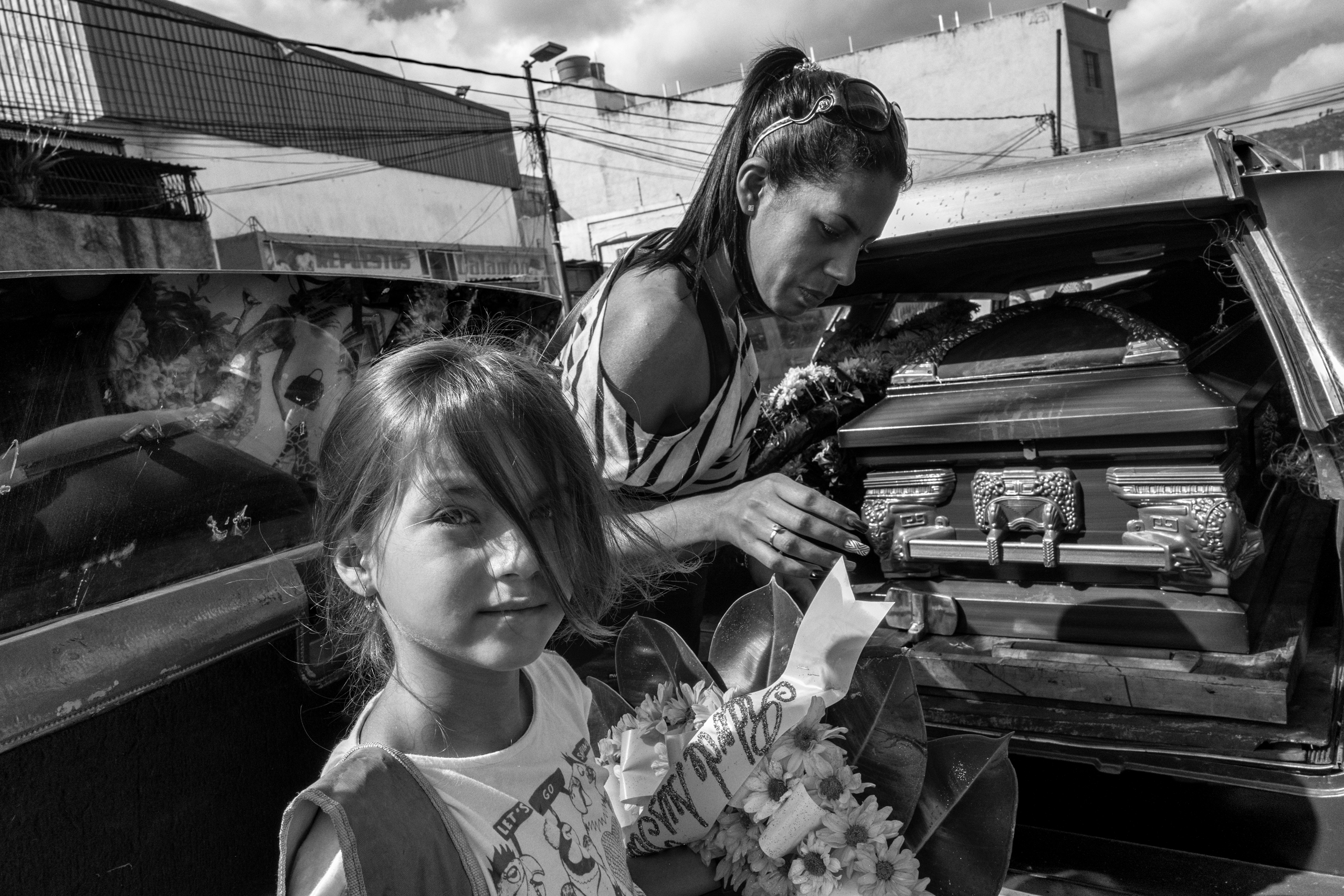 The young niece of 25 year-old Fredy Guerrero, who died after he was arrested by police, prepares to attend his funeral with other family members, June 2016.