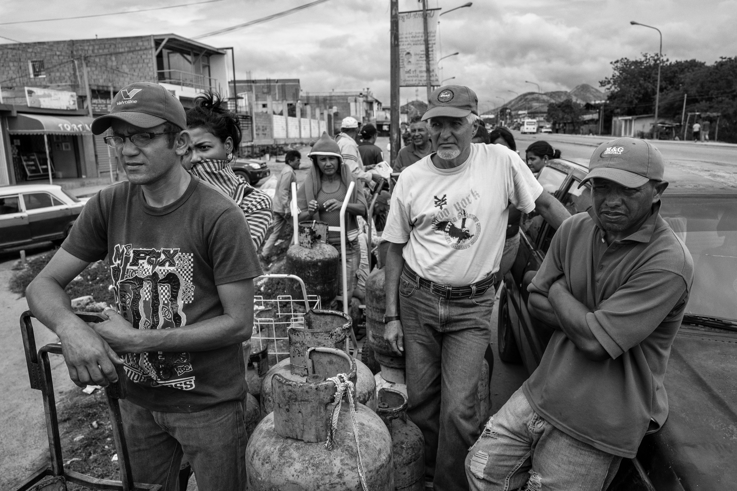 People line up for gas, which is needed for cooking and hot water. Because of severe shortages in the country, tension and discontent among the civilian population has grown resulting in outbreaks of violence and looting throughout the country, Barquisimeto, Venezuela,   June 2016.