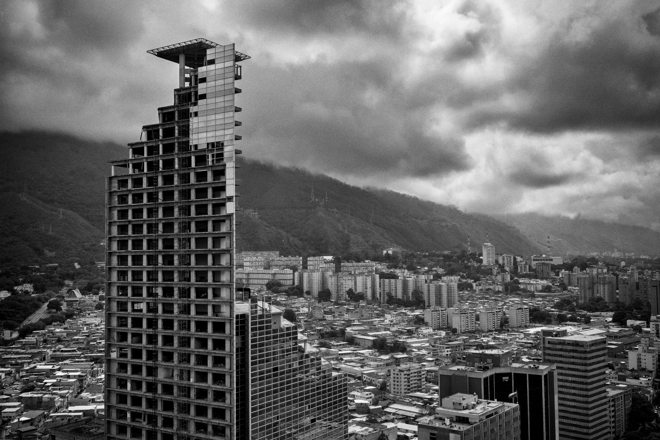 The Tower of David in Caracas was the worlds largest vertical slum, until its inhabitants were evicted. Insecurity and violence plagues the neighboring district around the tower, July  2015