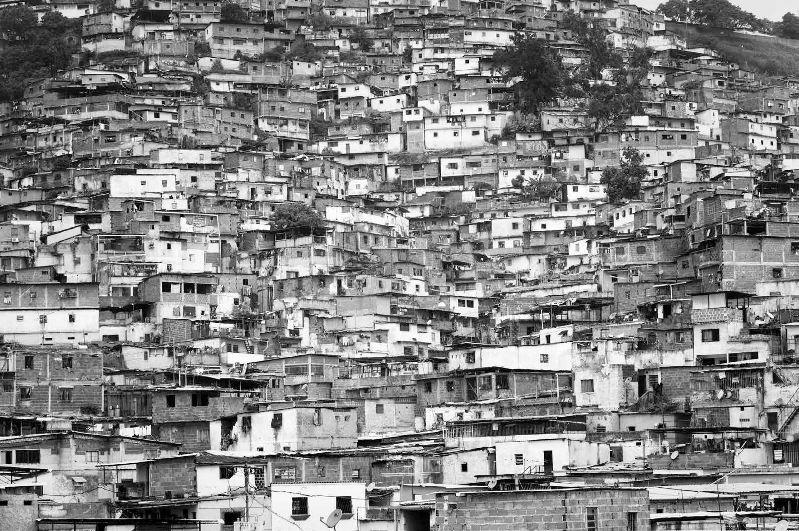 Catia  is one of the many slums in Caracas and a traditional stronghold of criminal gangs, known as colectivos. Supported by the government of President Hugo Chavez, the  colectivos became ideologically left wing groups that helped serve the Bolivarian revolution, 2009.