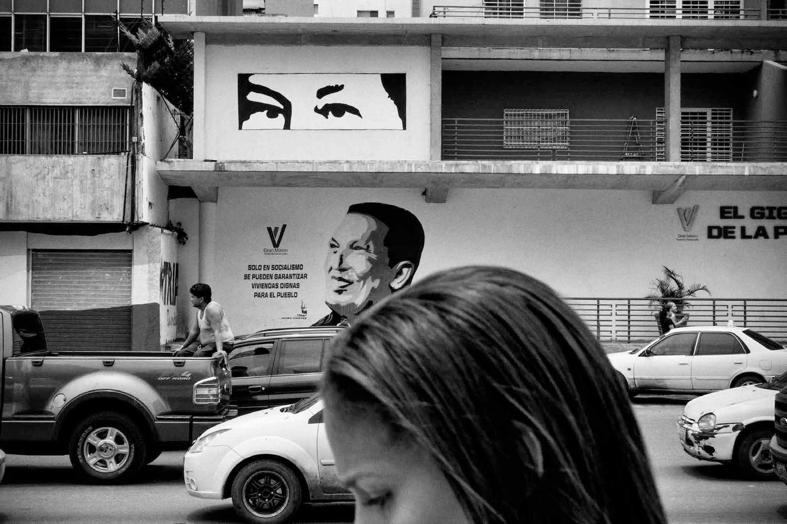 Images of former President Hugo Chavez are still pervasive around Venezuela, along with anti-imperialist and revolutionary propaganda graffiti. For the Venezuelan government, the personality cult surrounding the Bolivarian leader helps keep the spirit of the revolution alive, Caracas, July 2015.