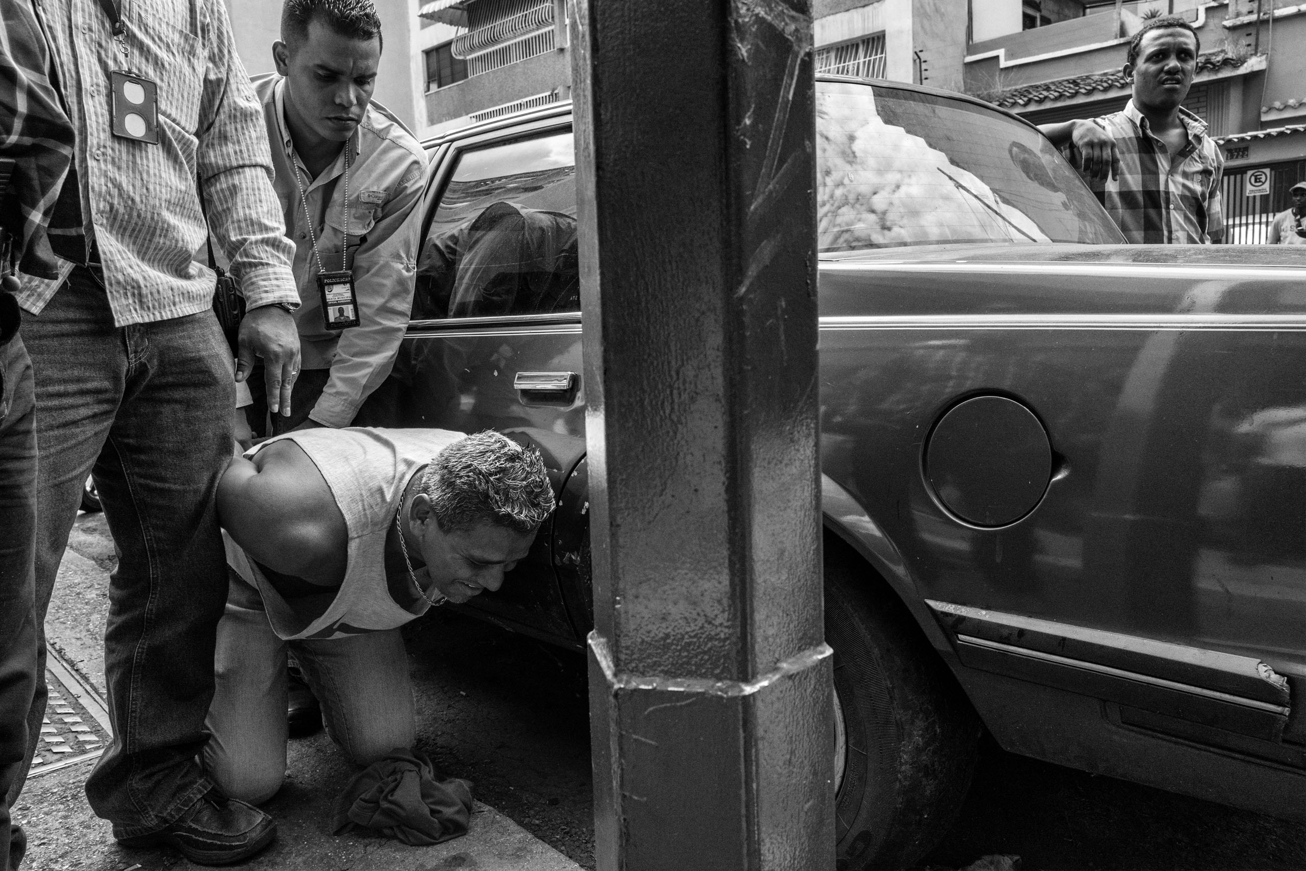 An alleged thief is arrested by police in Caracas, Venezuela. The economic and political crisis in Venezuela has led to increased crime and abuses by police, May 2016.
