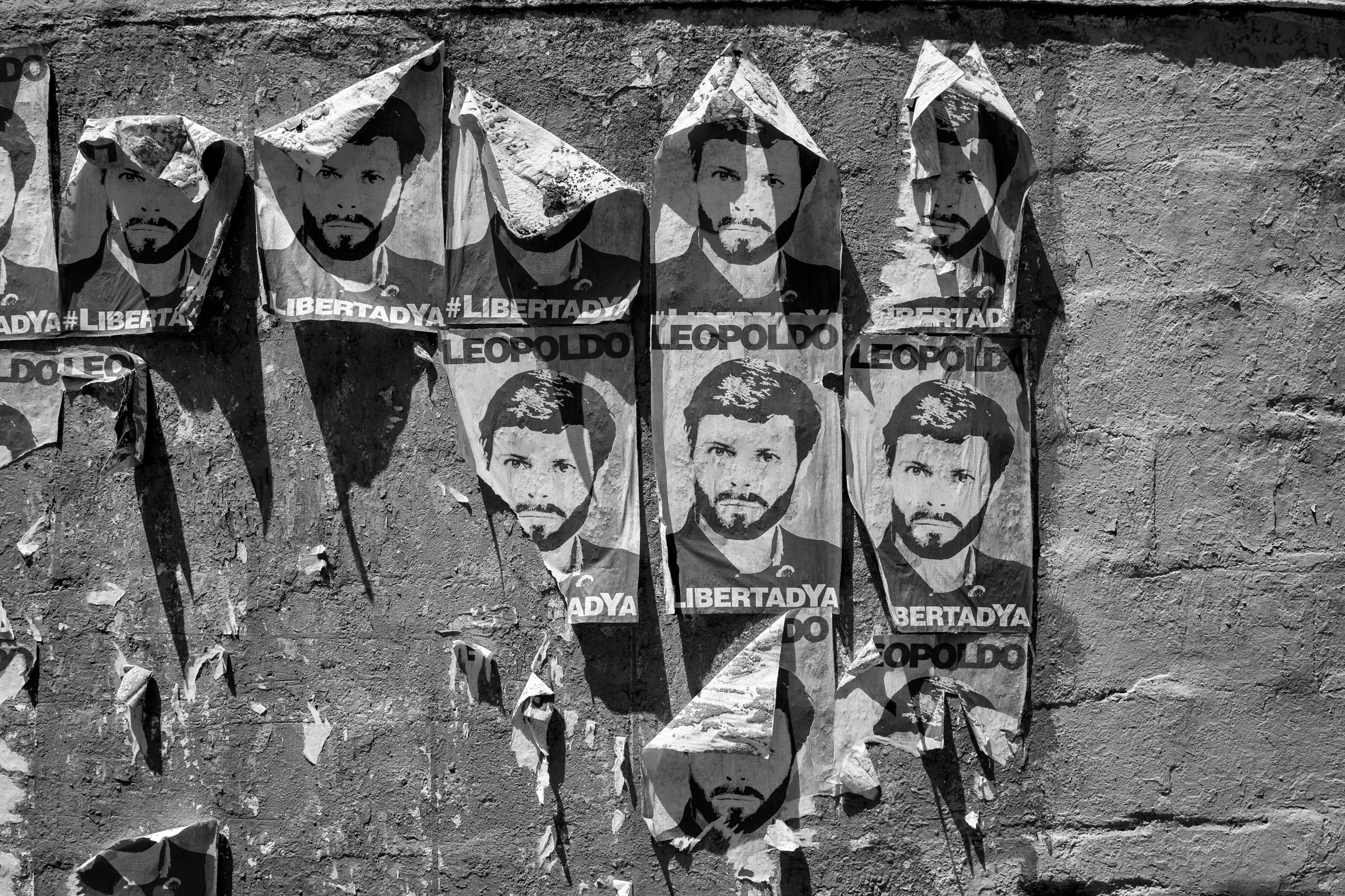 Posters of political prisoner Leopoldo Lopez hang on a wall in Caracas. The Venezuelan government of President Nicolas Maduro has been widely condemned for its treatment of the political opposition, including most notably Leopoldo Lopez, leader of the opposition, who is serving a 14-year sentence,  June, 2016.