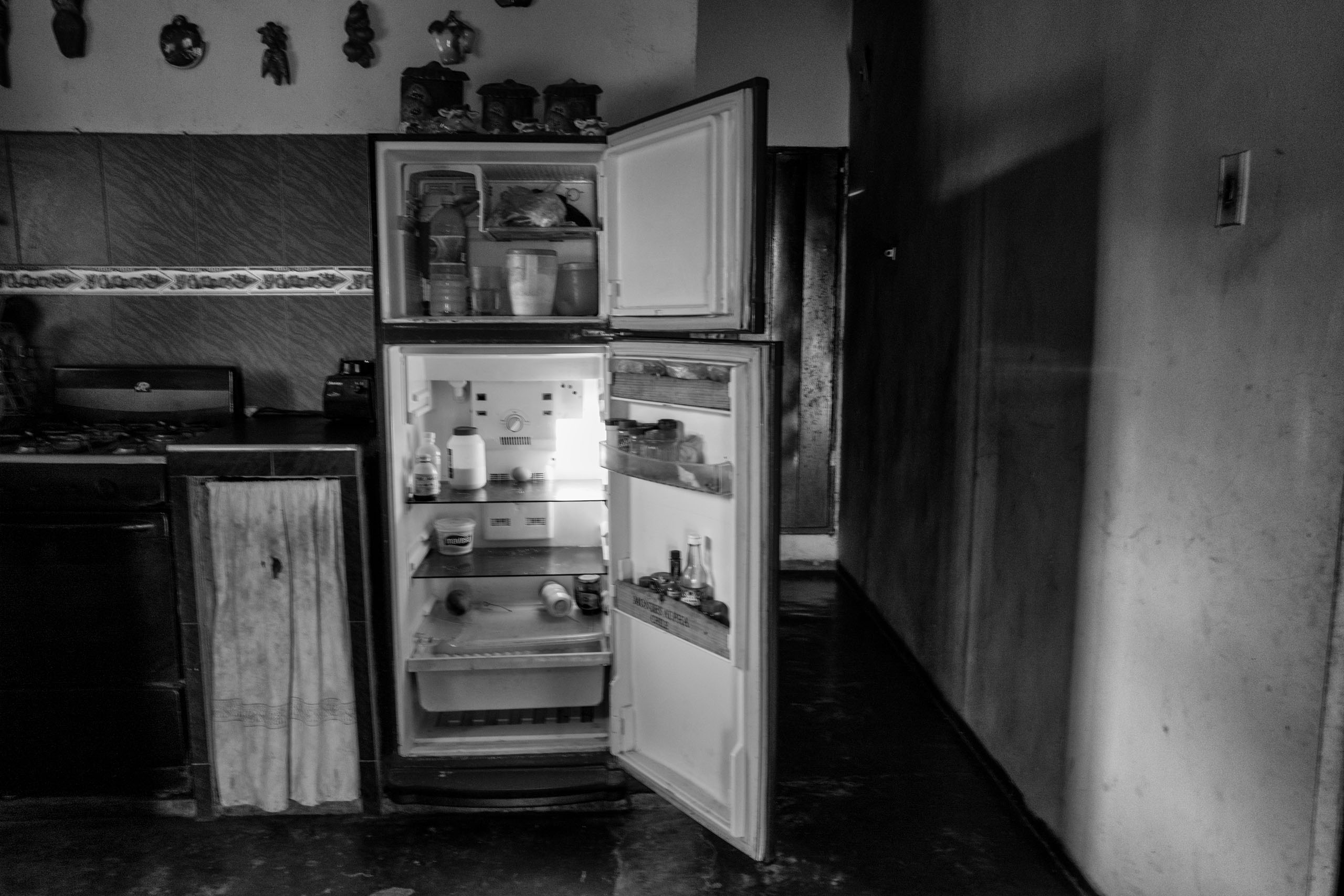 Severe food shortages often result in bare refrigerators, like this one in the home of Don Jose Luis, Barquisimeto, Venezuela, June 2016.