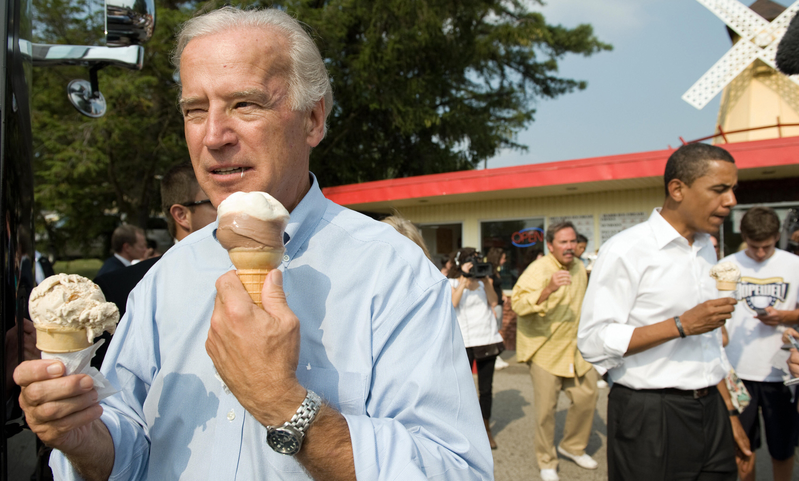 Vice presidential nominee Senator Joe Biden and Democratic presidential nominee Senator Barack Obama enjoy ice cream cones as they speak with local residents at the Windmill Ice Cream Shop in Aliquippa, Penns. on Aug. 29, 2008.