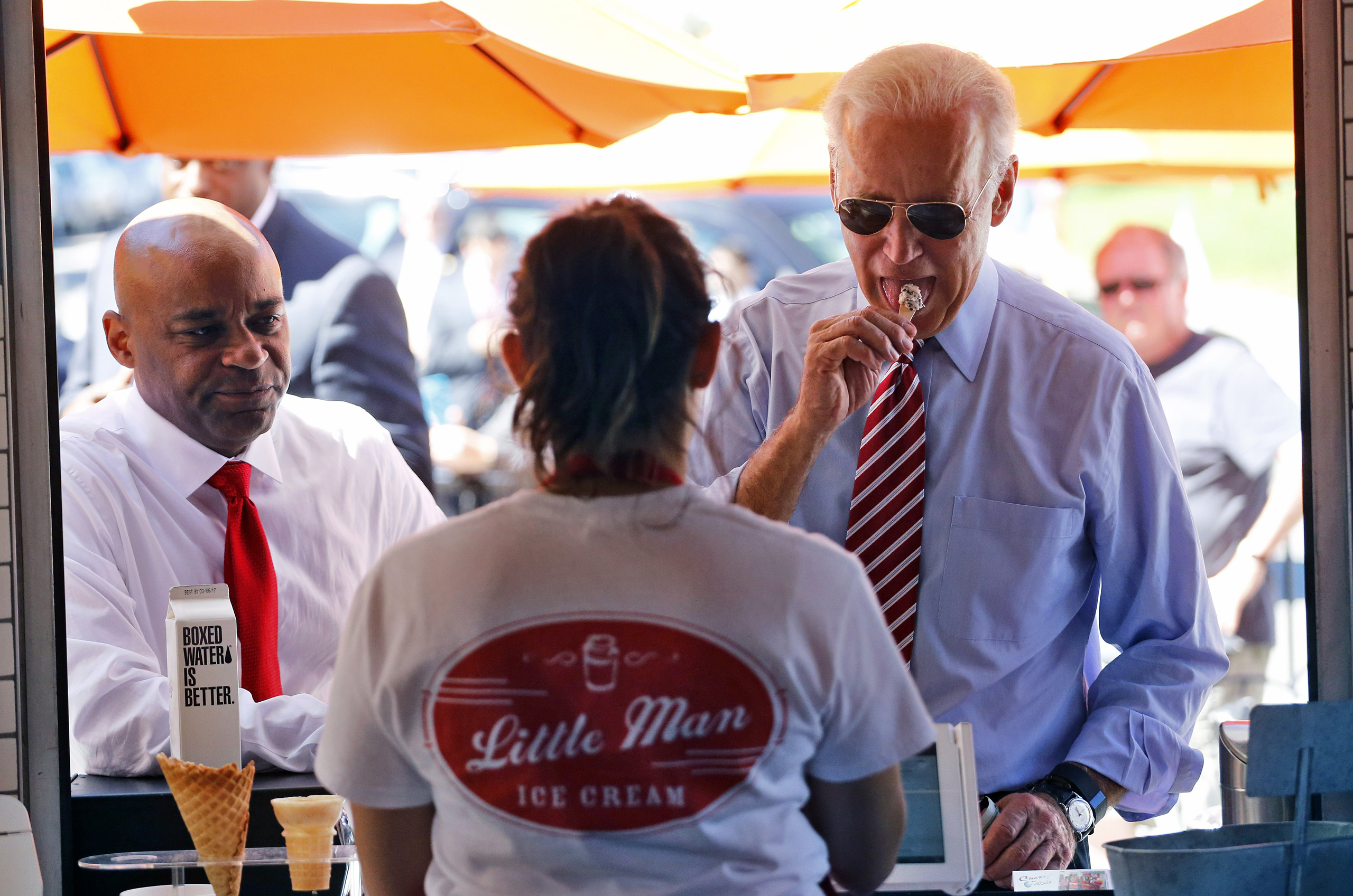 Vice President Joe Biden tastes different ice creams during a visit to Little Man Ice Cream, in Denver on July 21, 2015.