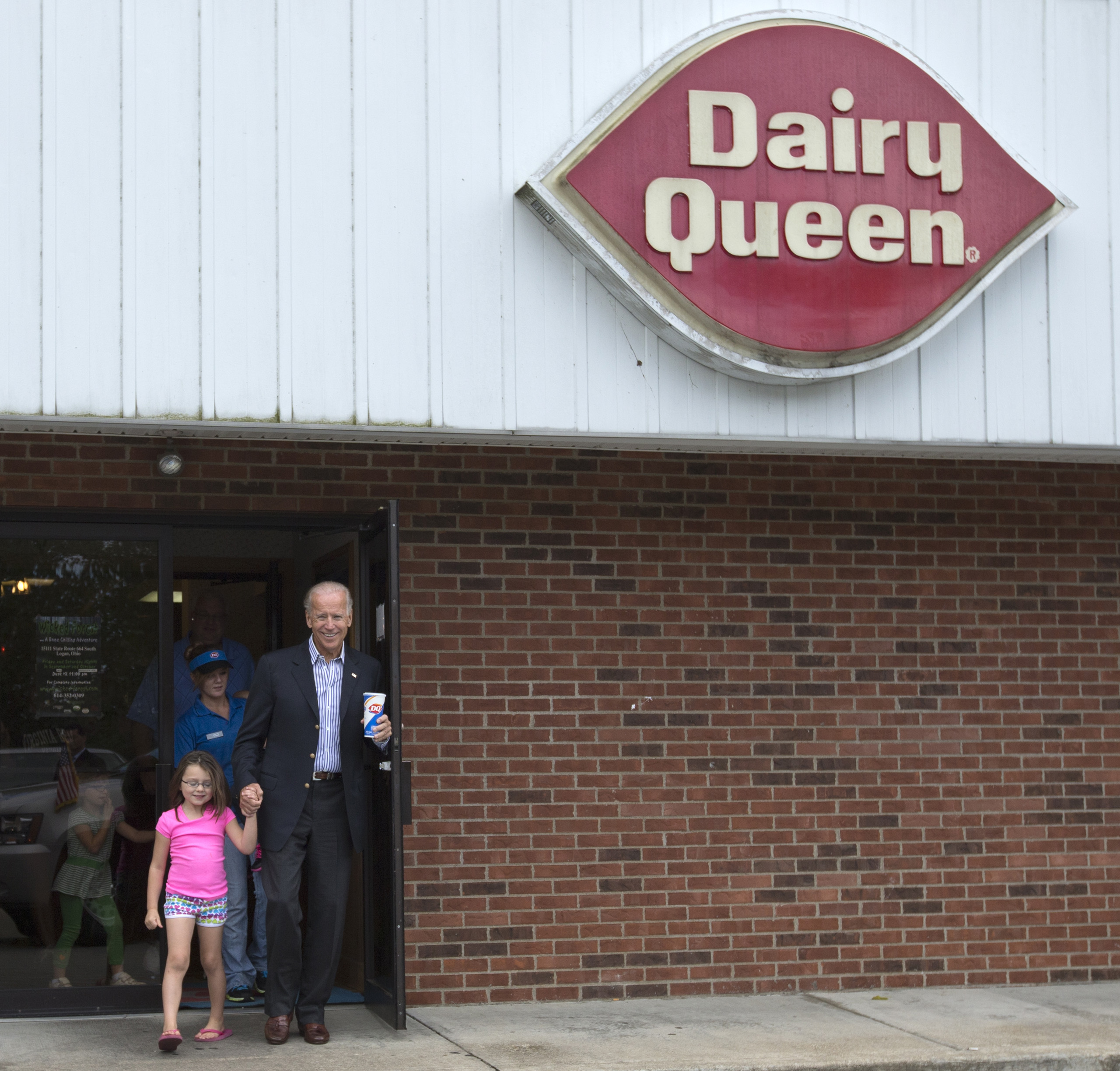 Joe Biden leaves Dairy Queen with an ice cream cone, holding the hand of a little girl, in Nelsonville, Ohio, on Sept. 8, 2012.