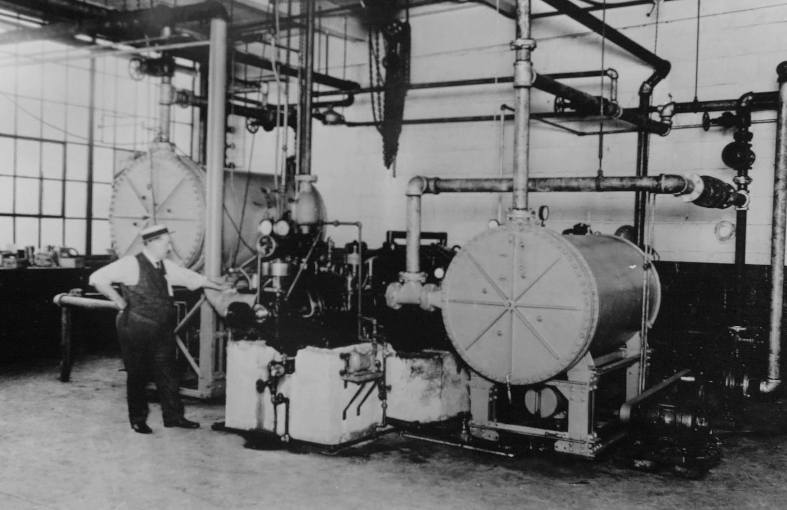 The first centrifugal refrigeration machine invented by Willis H. Carrier, the father of air conditioning, is pictured in Syracuse,  New York in 1922.