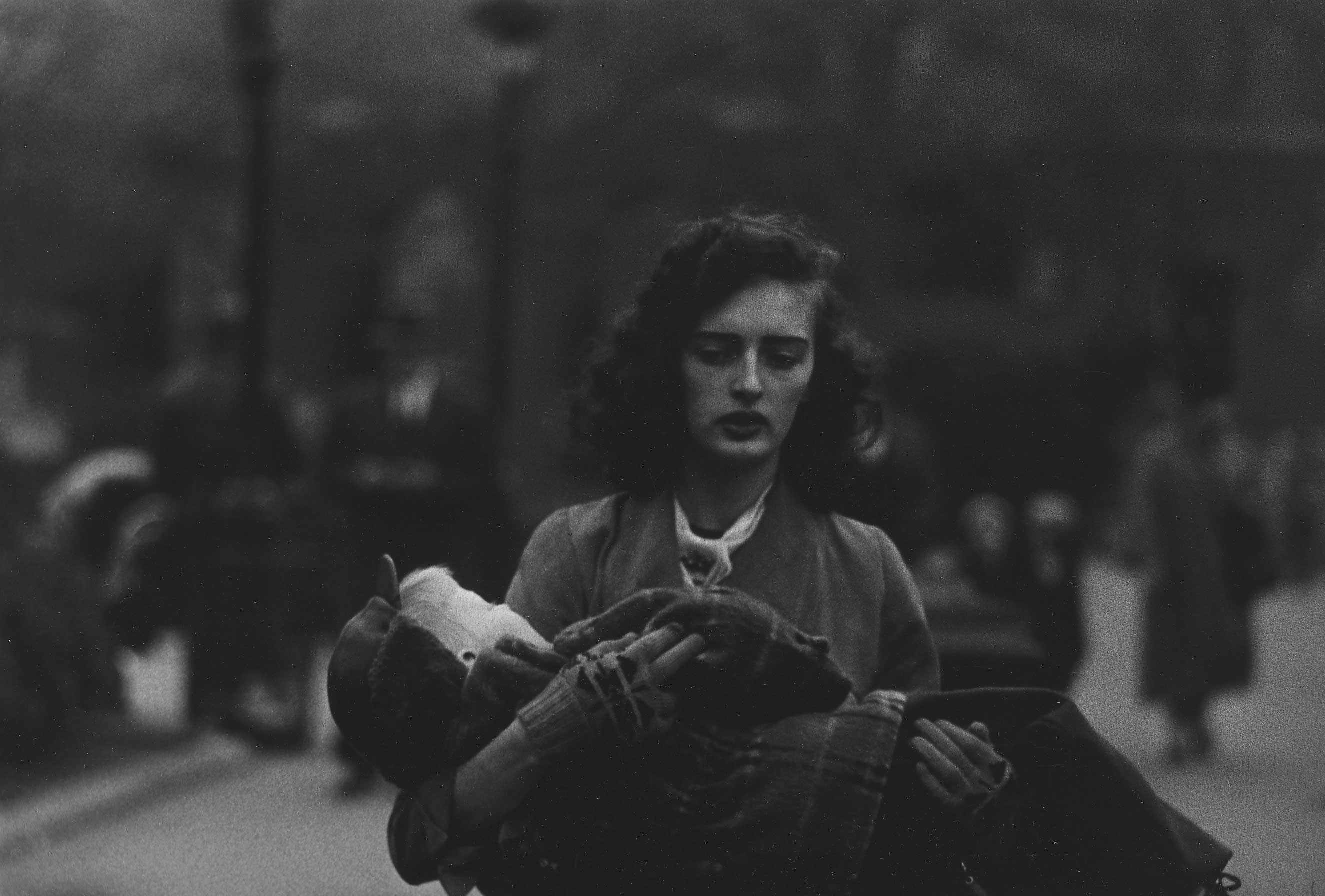 Woman carrying a child in Central Park, N.Y.C., 1956                               Tod Pappageorge: I knew a good bit of this early work, so I can't say that I was really surprised by the pictures I hadn't seen before, apart from their number, and by how vividly they confirmed just how all-engrossing, and defined, Diane's photographic project was right from the beginning. That said, I found myself generally most moved by her pictures of, what I would call, members of her own very upper middle-class world (a world she was at such pains to reject). All women, I think. For example, a mother (I'd guess) moving toward Diane's camera carrying a child in Central Park.