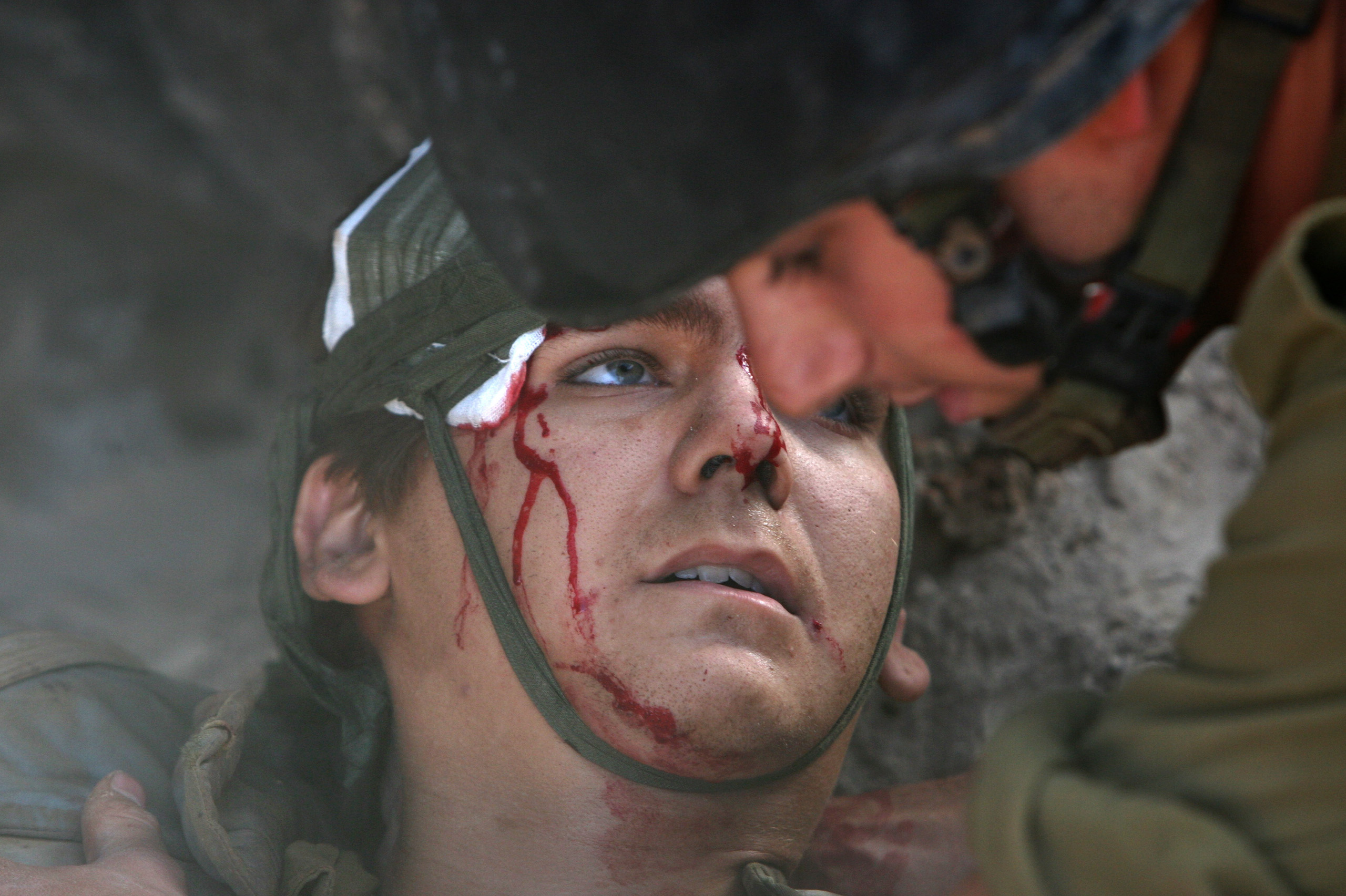 "This image I took, as the only embedded photographer with the Israeli Defense Forces in Lebanon (IDF),  depicts a classic  sacrifice  visual narrative of a hero giving his life for his nation. I was told by several people that it was 'very Vietnam'. Since this image was not overtly gruesome and since the soldier survived his injuries, it could be prominently displayed. I later learned that this scene actually represents a victim of a friendly fire incident, though it had already circulated and had been published with the caption that this soldier had been wounded in a Hezbollah attack. Because I insisted that information be included in the caption, the image lost value as a propaganda tool. This soldier was inconveniently hit by the wrong explosives.                                          I have come to believe that embedded 'war photography' simplifies the brutal ambiguity of conflict into well-worn and widely recognized visual templates. We, ""war photographers,"" help in reinforcing masculine myths of war as a purging experience. As it stands, I believe my images did a great disservice to the people who died or participated in this unnecessary and farcical demonstration of force in 2006, which besides claiming the lives of more than one hundred Israeli soldiers, also killed almost 30 times more Lebanese civilians than the 44 Israeli civilian dead. This conditioned Israeli public opinion to accept similar carnage in Gaza in 2009 and 2014 as a reasonable response."