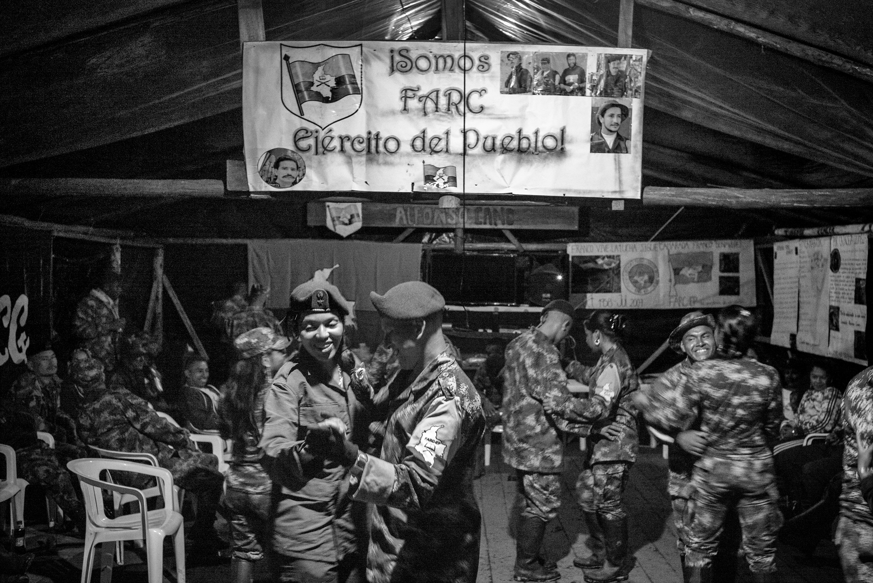 Revolutionary Armed Forces of Colombia (FARC) guerrilla members dance during a party at a camp. For fity-two years, FARC has been an armed movement in Colombia. With the peace agreements reached in Havana on August 24, 2016, it will begin to move towards becoming a political movement, Cauca, Colombia, July 2016.