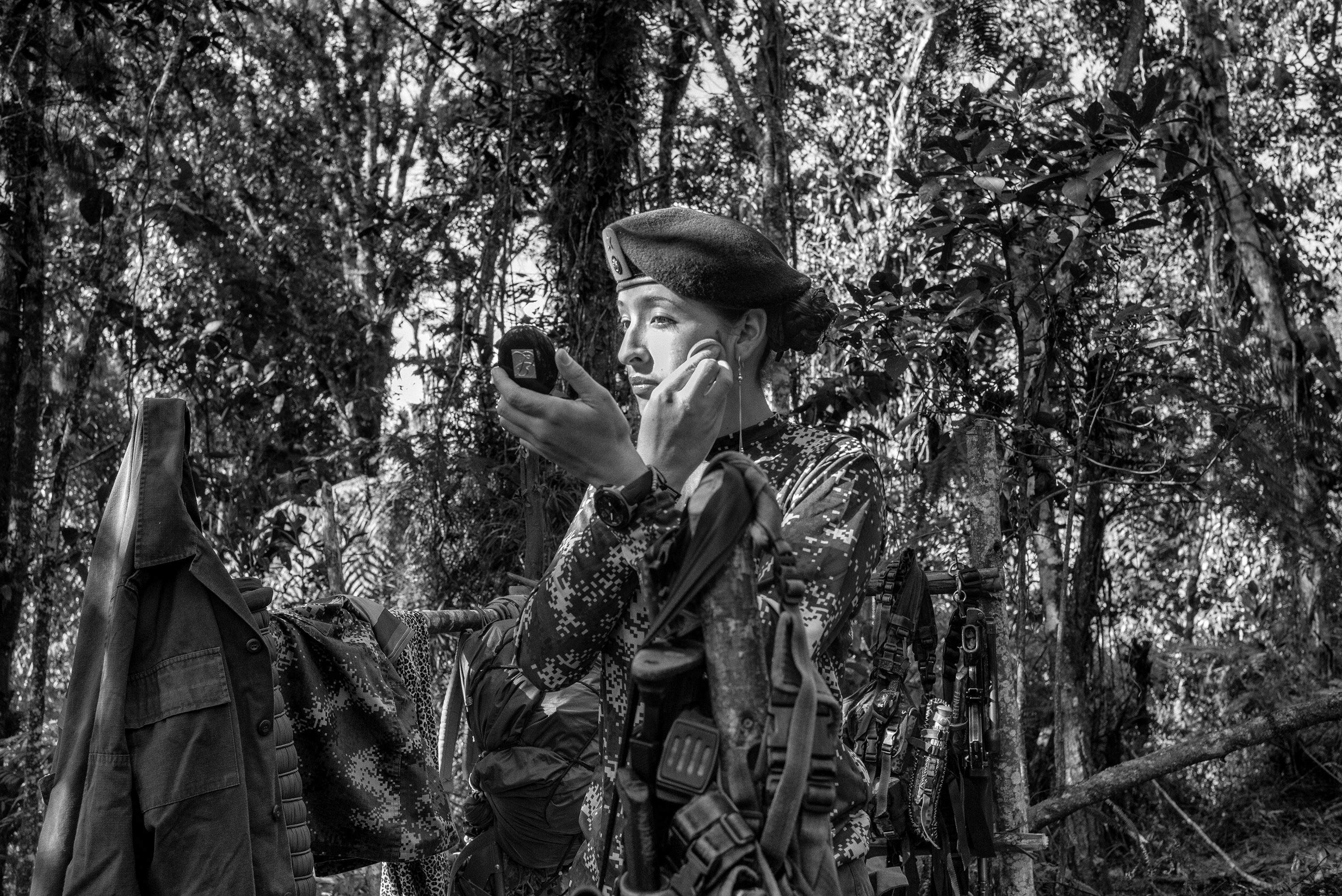 Tania, A FARC guerrilla member,  puts on makeup at a camp, Cauca, Colombia. On Oct. 2, 2016, Colombians will vote in a referendum to end Colombia's  52-year old conflict between FARC, the military and right-wing paramilitaries, July 2016.