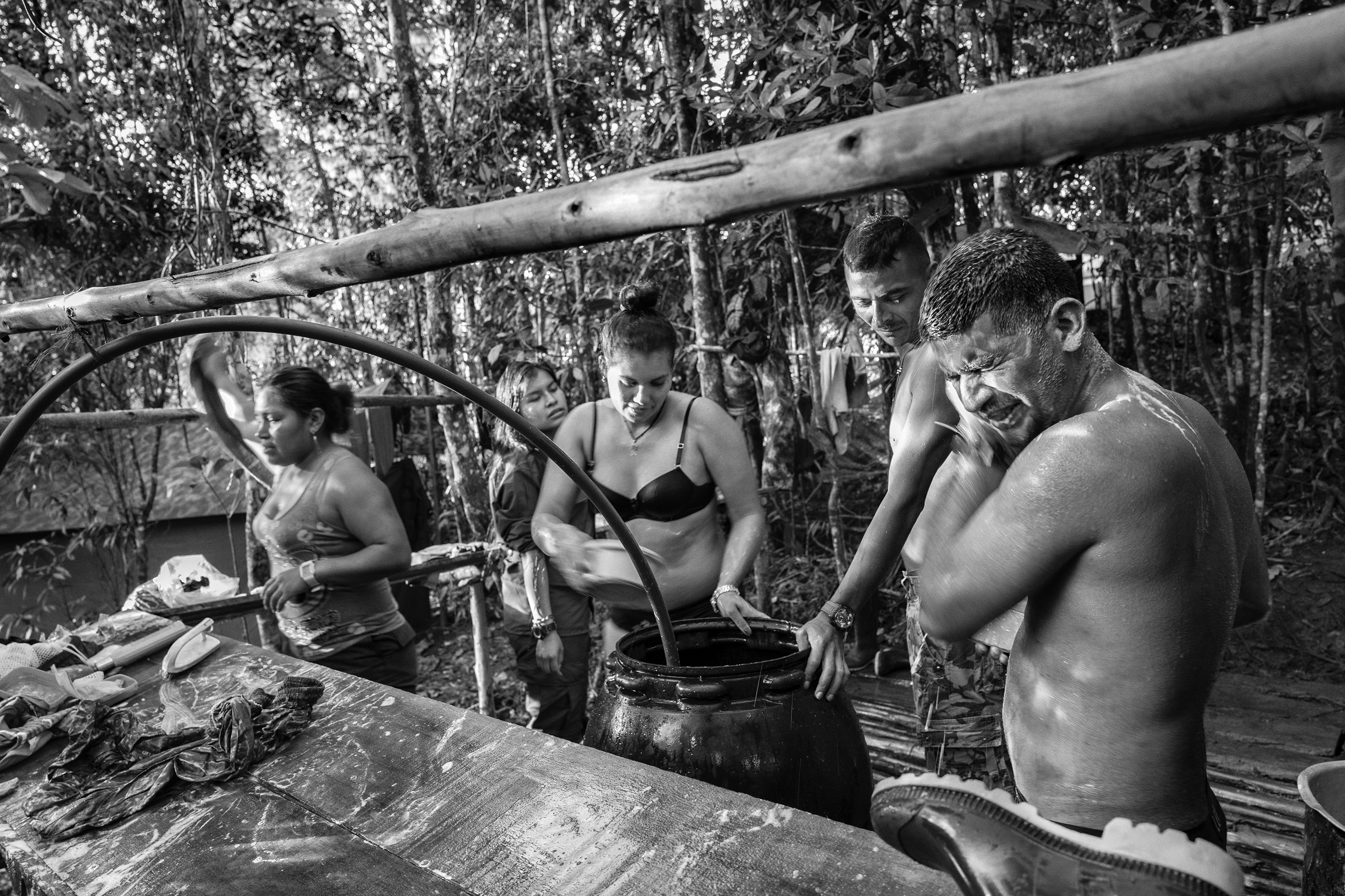 FARC guerrilla members shower at a camp, Cauca, Colombia, July 2016.