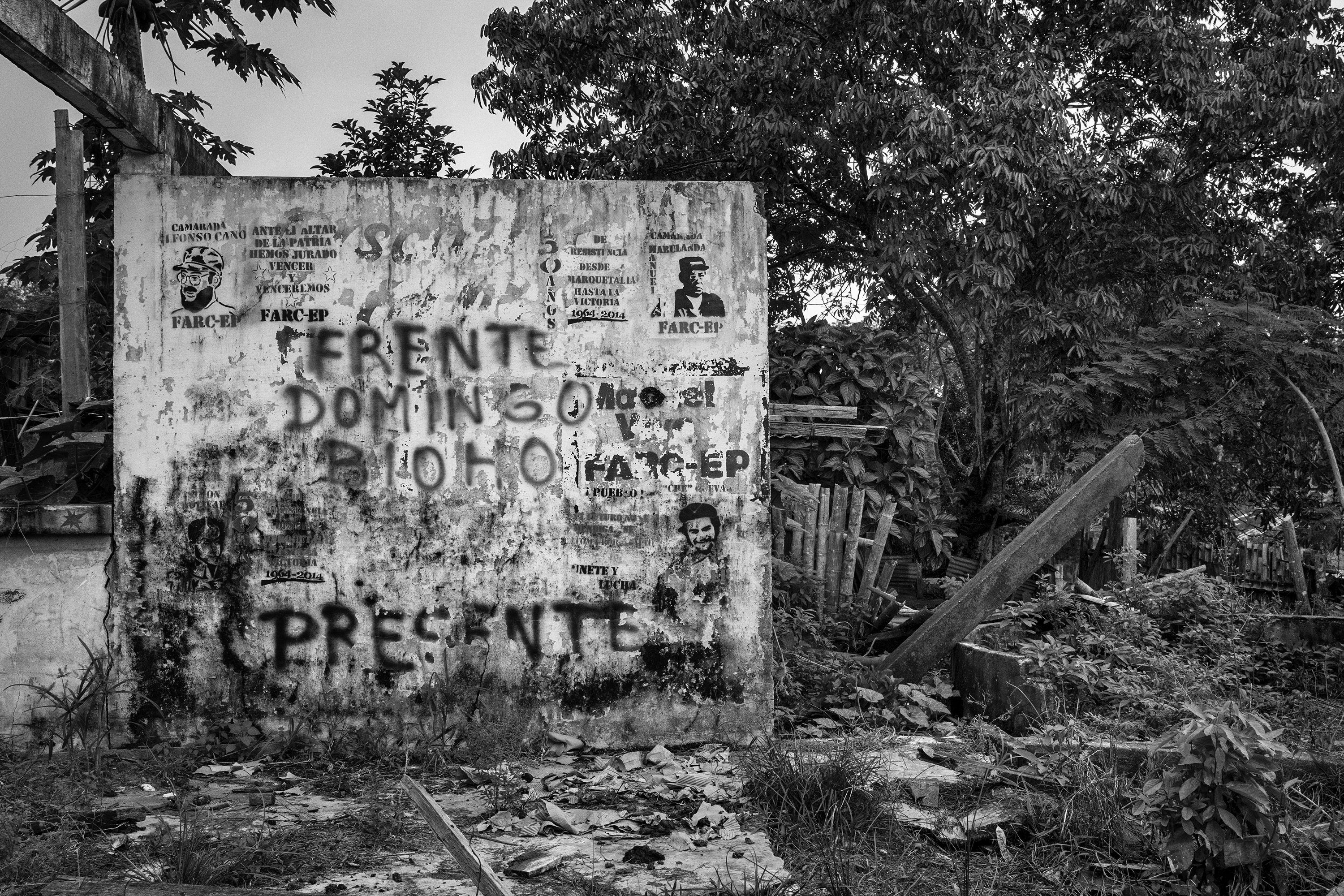 A wall destroyed by the conflict in the community of Santo Domingo del Caguan shows propaganda from FARC, Caqueta, Colombia, April 2016.