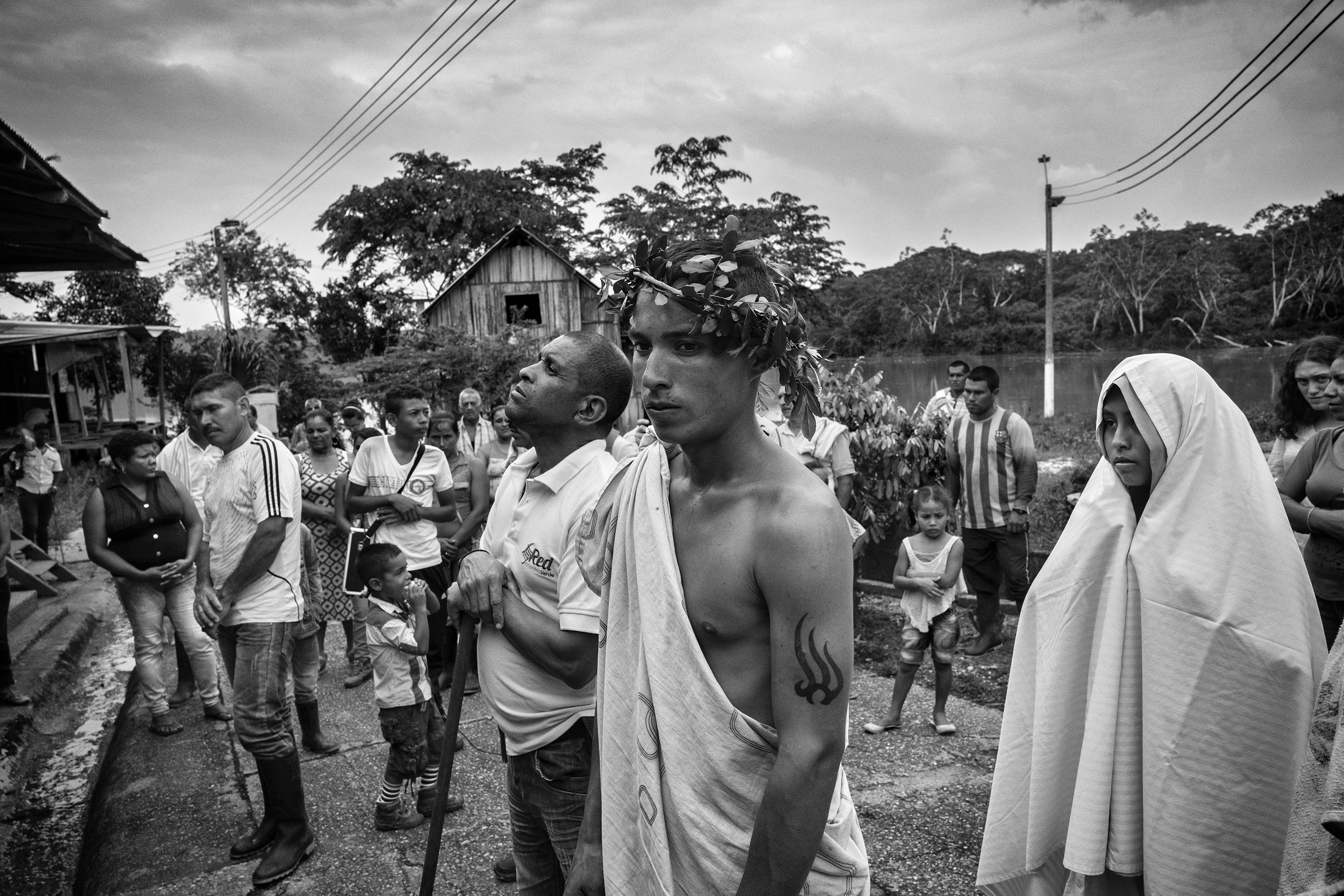 A group of local civilians attend Easter celebrations in the community of Puerto Camelias del Caguan, Caqueta, Colombia, April, 2016.