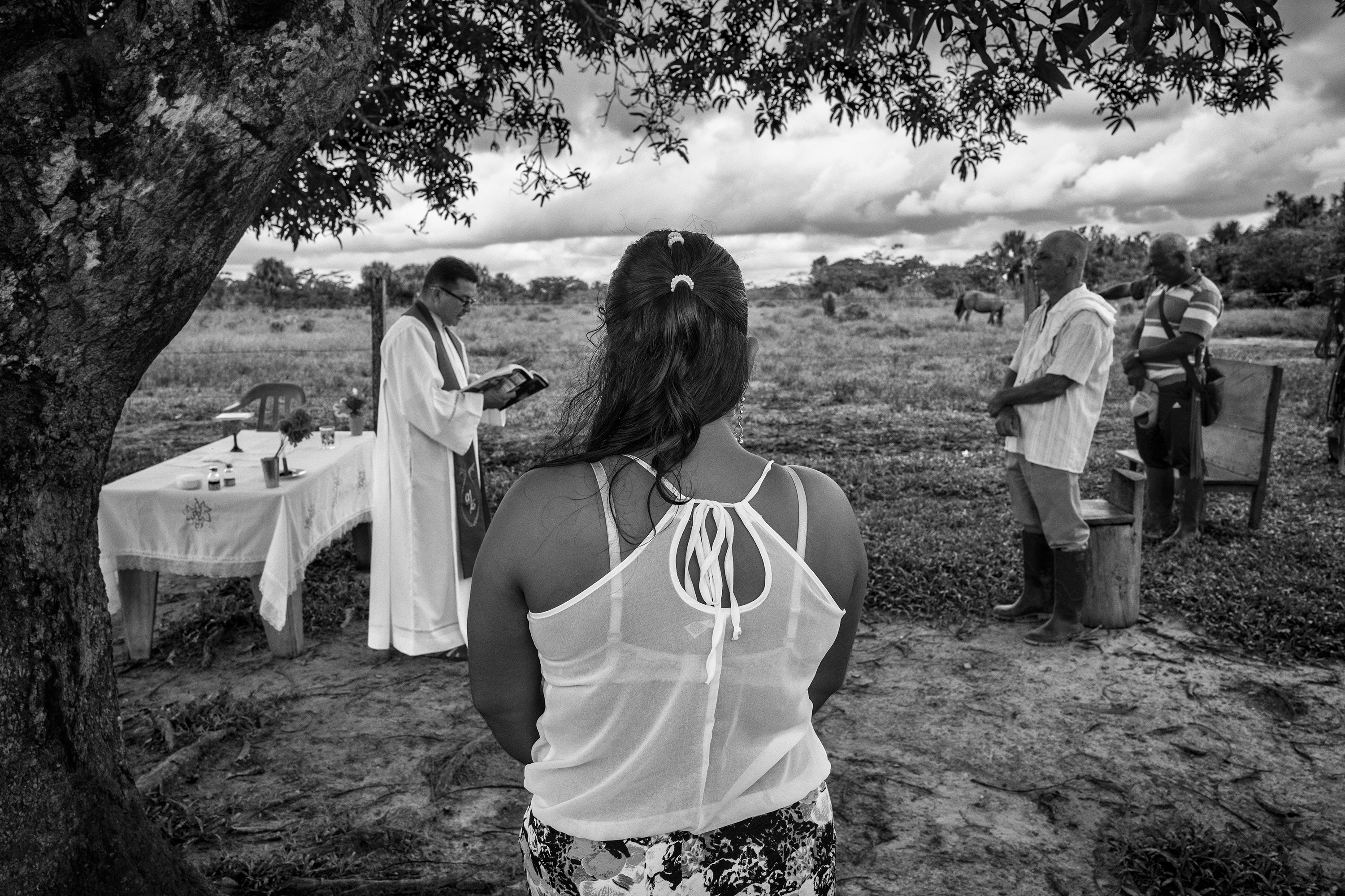 A group of civilians attend a Catholic Mass in the community of Puerto Camelias del Caguan. Both religion and FARC play central roles in communities where FARC has been the only authority for over 50 years, Aug. 24, 2016