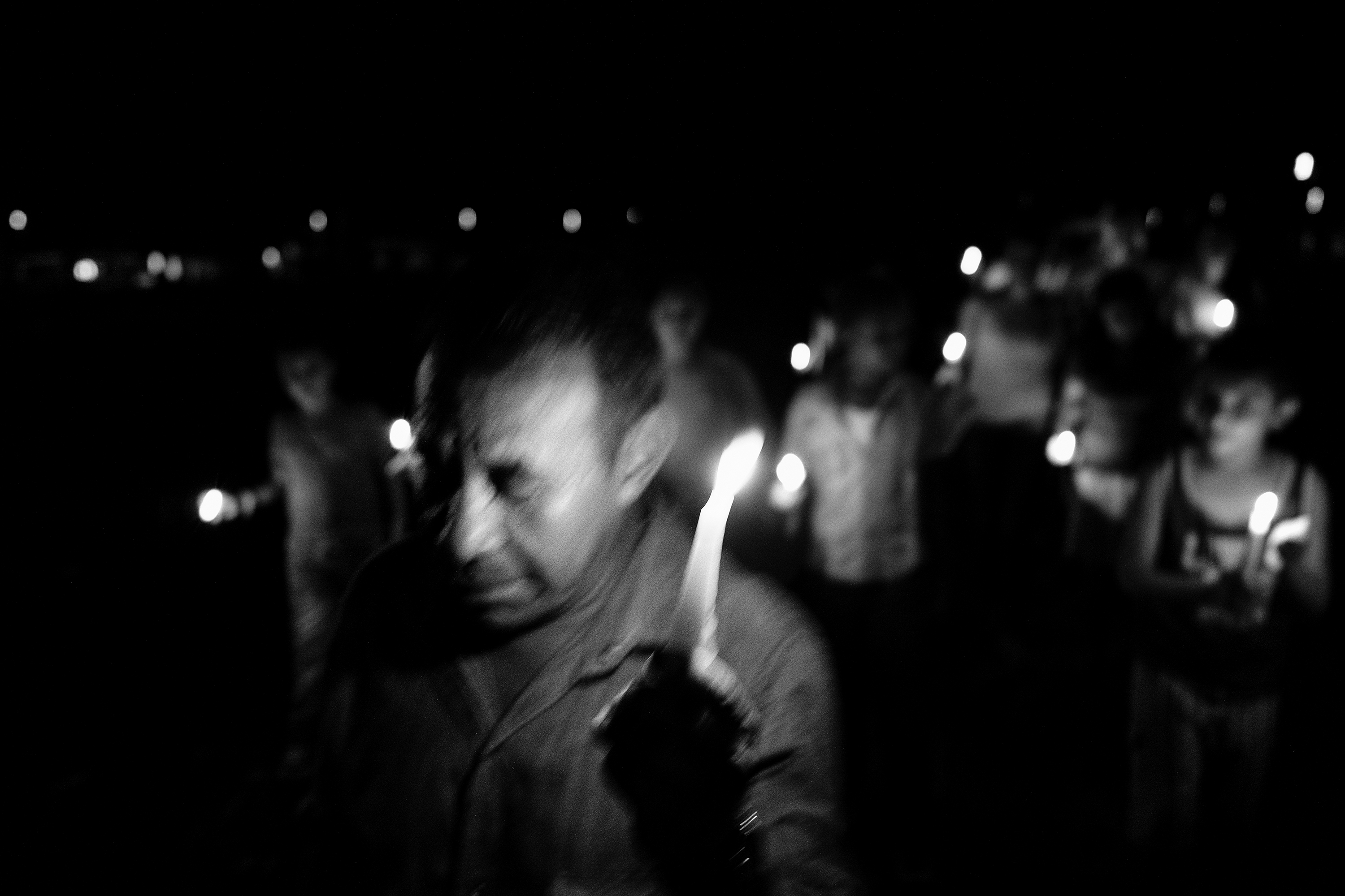 Holding candles, members of the community from Re- moiinos del Caguan attend a vigil for peace. Since the unilateral ceasefire announcement of the FARC, there are signs of the re-emergence of paramilitary units in the region, Caqueta, Colombia, April 2016.