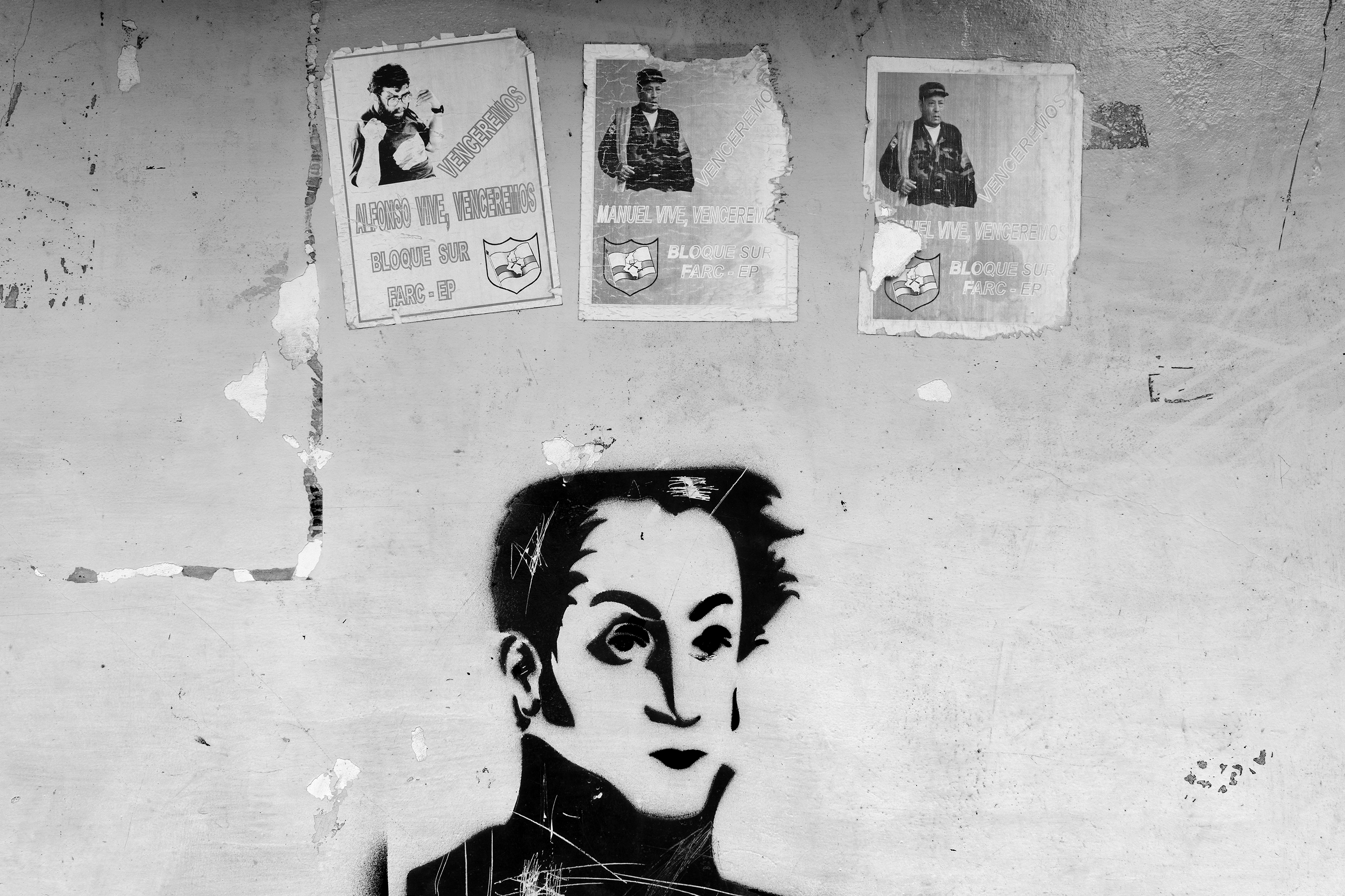 An image of Bolivar and propaganda posters of the historic leaders of FARC on a wall of a house, Nov. 2013 in San Isidro, Caqueta, Colombia.                                The FARC South Block commands main FARC strongholds.