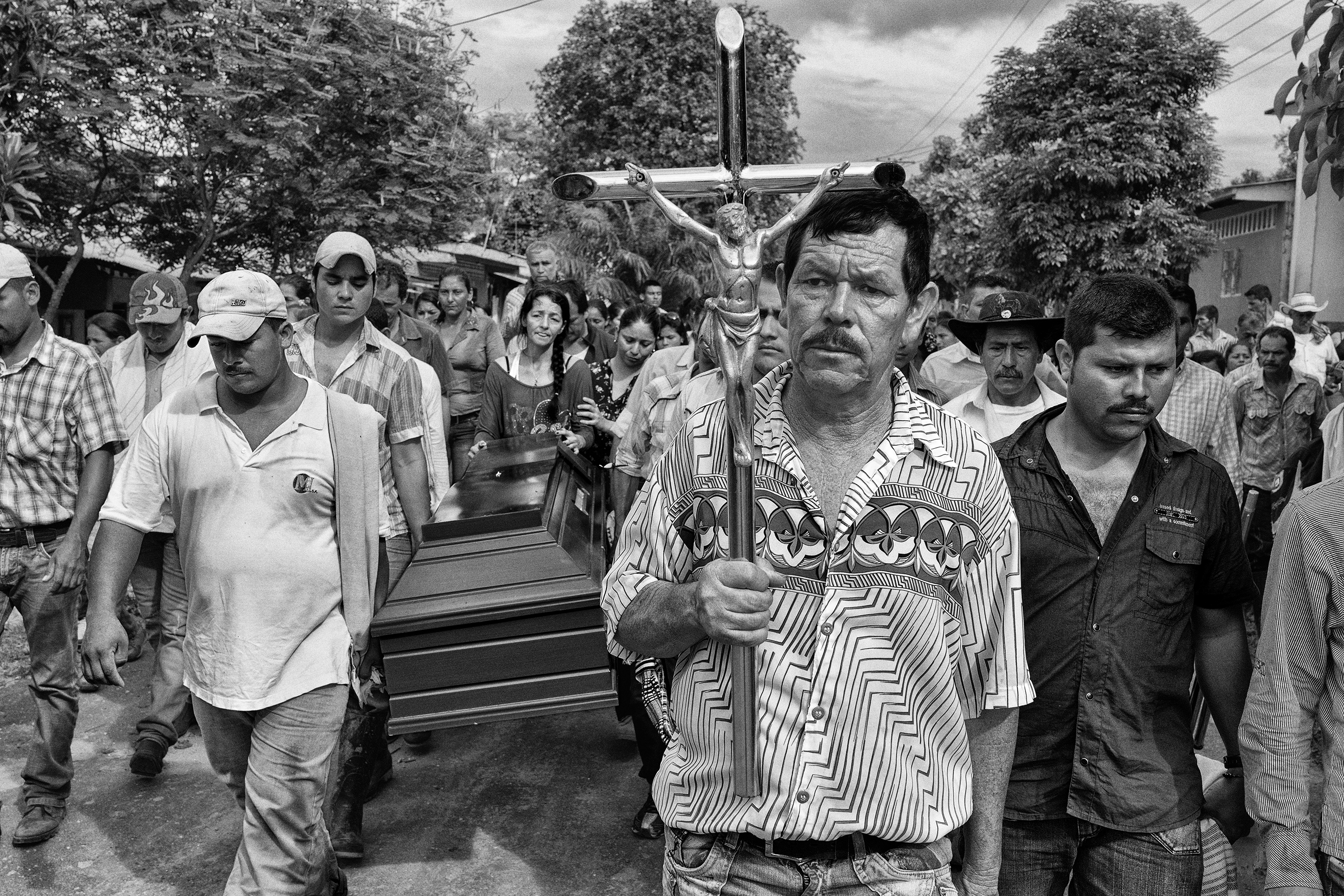 Relatives and friends carry the body of 18-year old Benjamin to the cemetery for burial, Nov. 2013, La Union Peneya, Caqueta, Colombia, Nov. 2013. Benjamin died at age 18 during a fight with the FARC guerrillas.