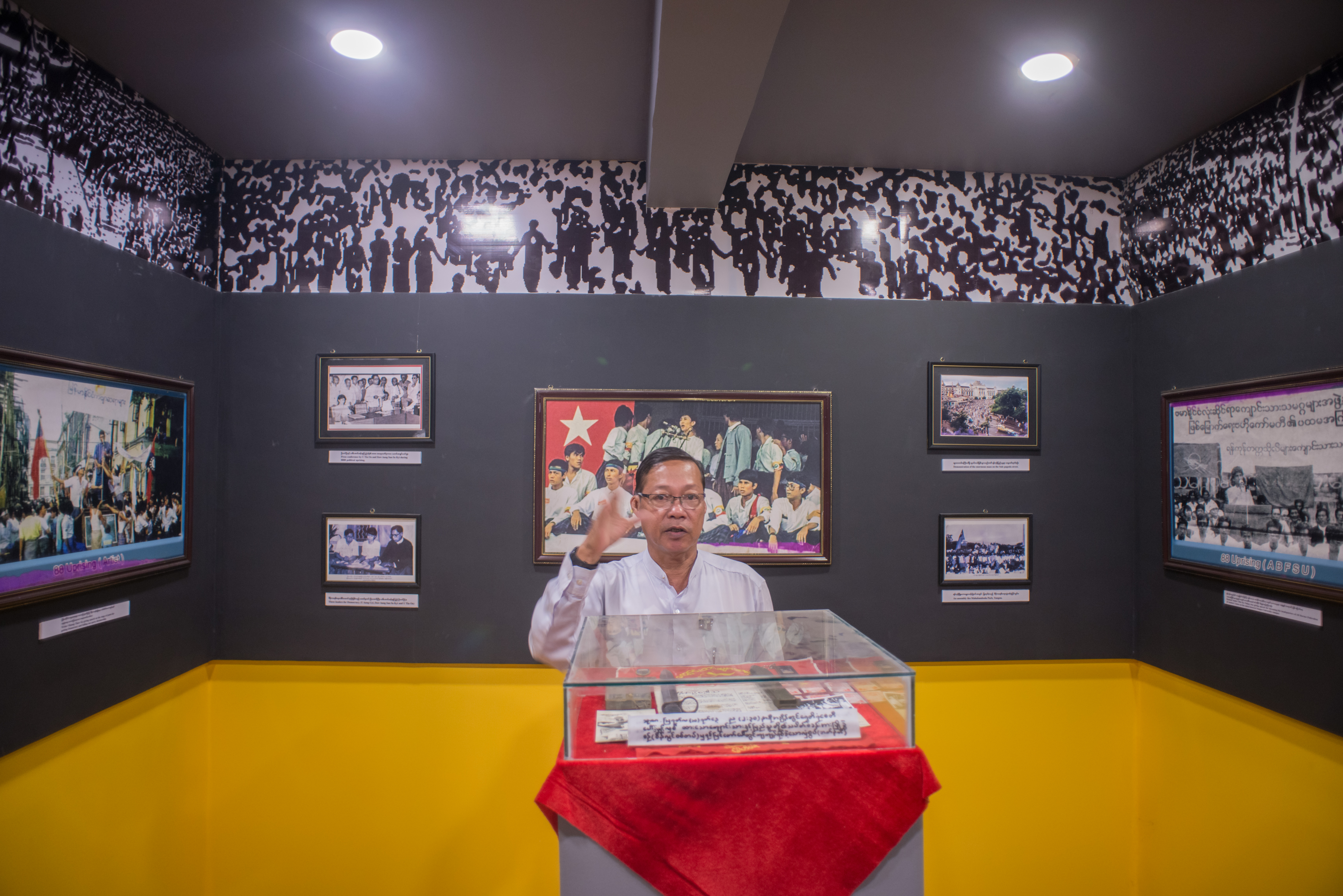 Former student activist Aung Maw speaks to visitors at the 88 Memorial Hall in Rangoon, Burma, on June 3, 2016