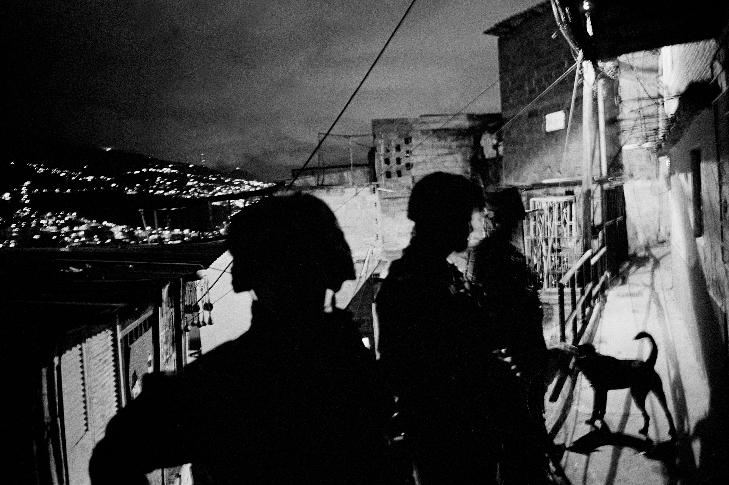"""A group of soldiers patrol the streets of """"La Comuna"""" number 13, a neighborhood with many FARC militants, and a stronghold for the distribution of cocaine, Medellin, Colombia, 2011."""