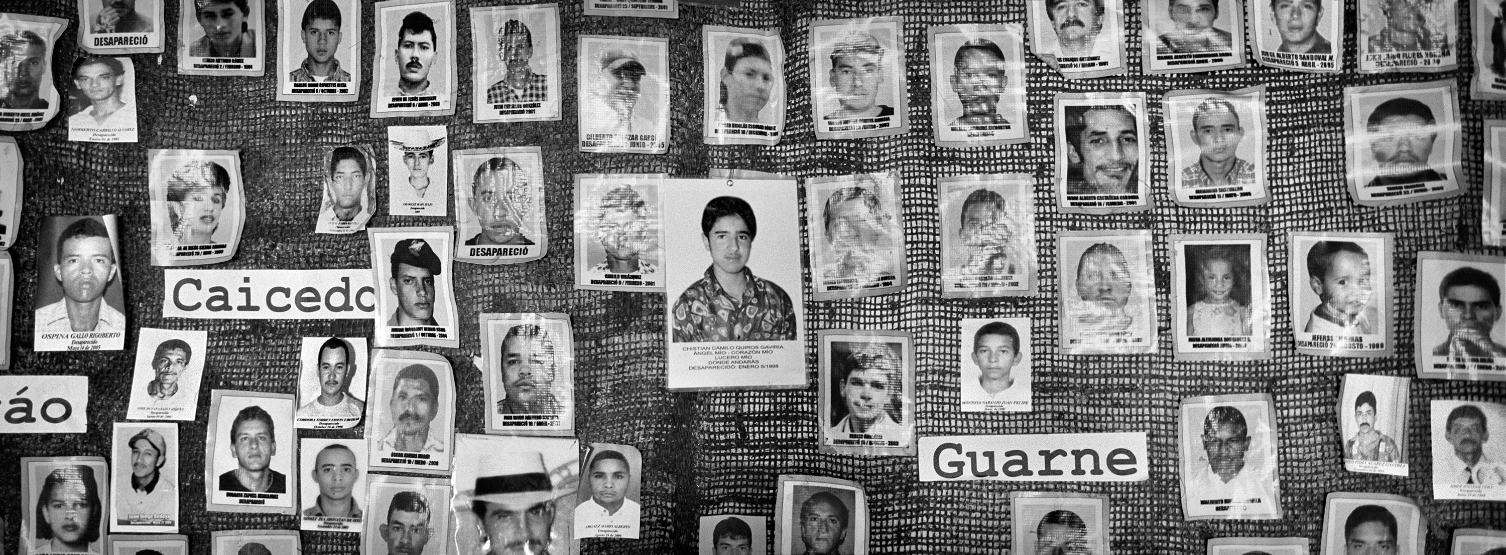 A mural with photographs of missing people from the war in Antioquia, Colombia, Feb. 2015. The association of the mothers of the Candelaria helps families find missing relatives. It was the first Association in Colombia which demanded answers about the fate of 96,000 missing people.