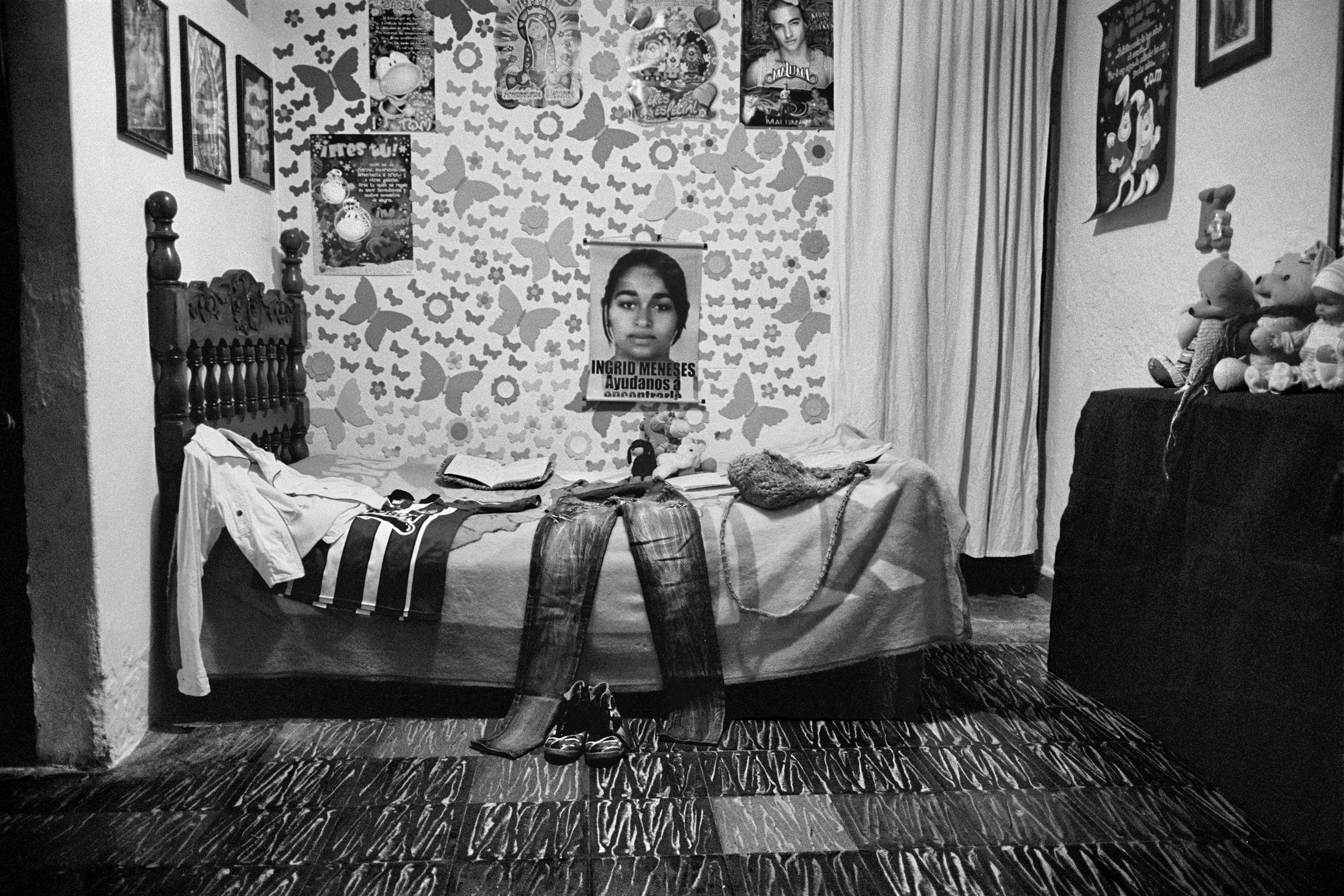 The bed of Ingrid Medarno Perez who disappeared in Yarumal, Colombia has become a shrine inside the family home of Martha and Antonio, Ingrid's parents. At eleven in the morning on Nov. 29, 2010, a member of the paramilitary group of the Urabeños went to her home, where she was with her boyfriend. It was not until March 2015, that Julian Bolivar, a former paramilitary commander informed the family that Ingrid and her boyfriend were executed that same day. Their bodies were crushed and thrown into the river. Their remains were never recovered, Feb. 2015.