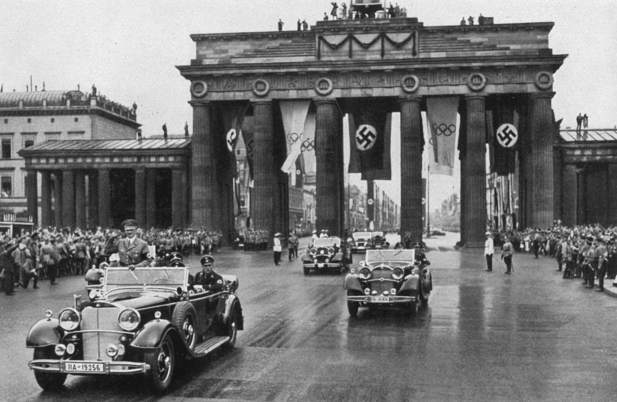 The Führer Adolf Hitler, Patron of the Olympic Games, drives through the lines of enthusiastic people to open the Games officially in 1936 in Berlin