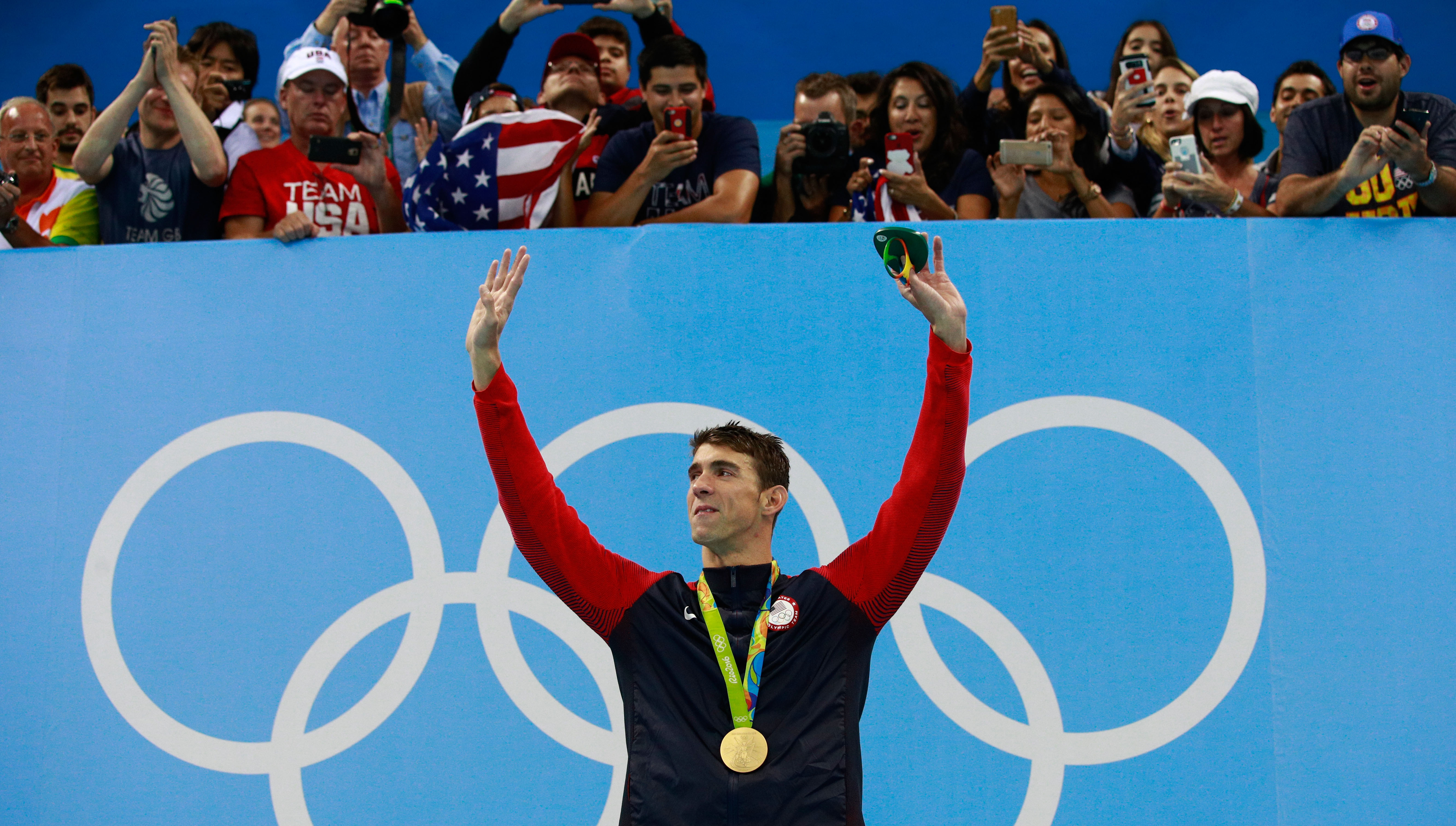 Michael Phelps poses on the podium during the medal ceremony for the Men's 200m Individual Medley Final at the Rio Olympic Games on Aug. 11, 2016 in Rio de Janeiro.
