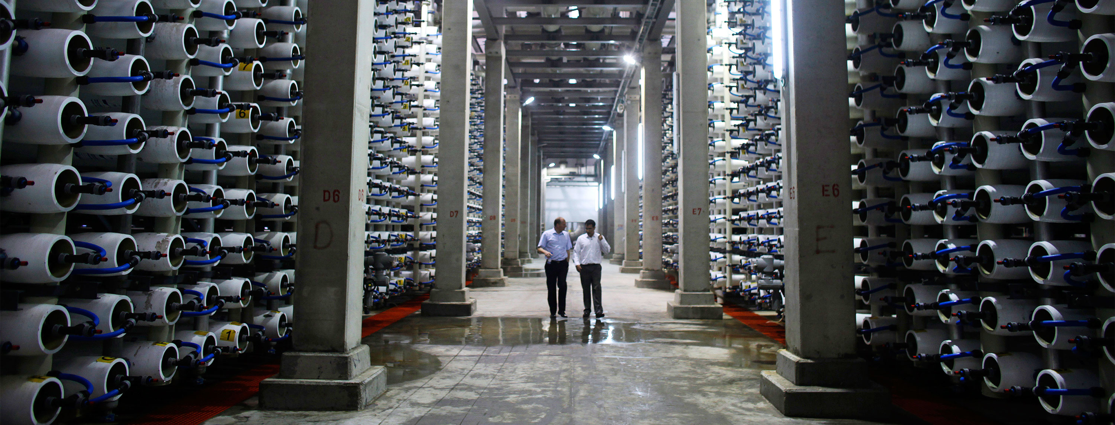 People walk in a desalination plant before during its inauguration in Hadera